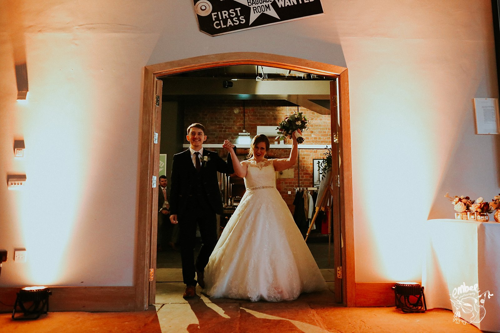 bride and groom cheer as they enter the dining room