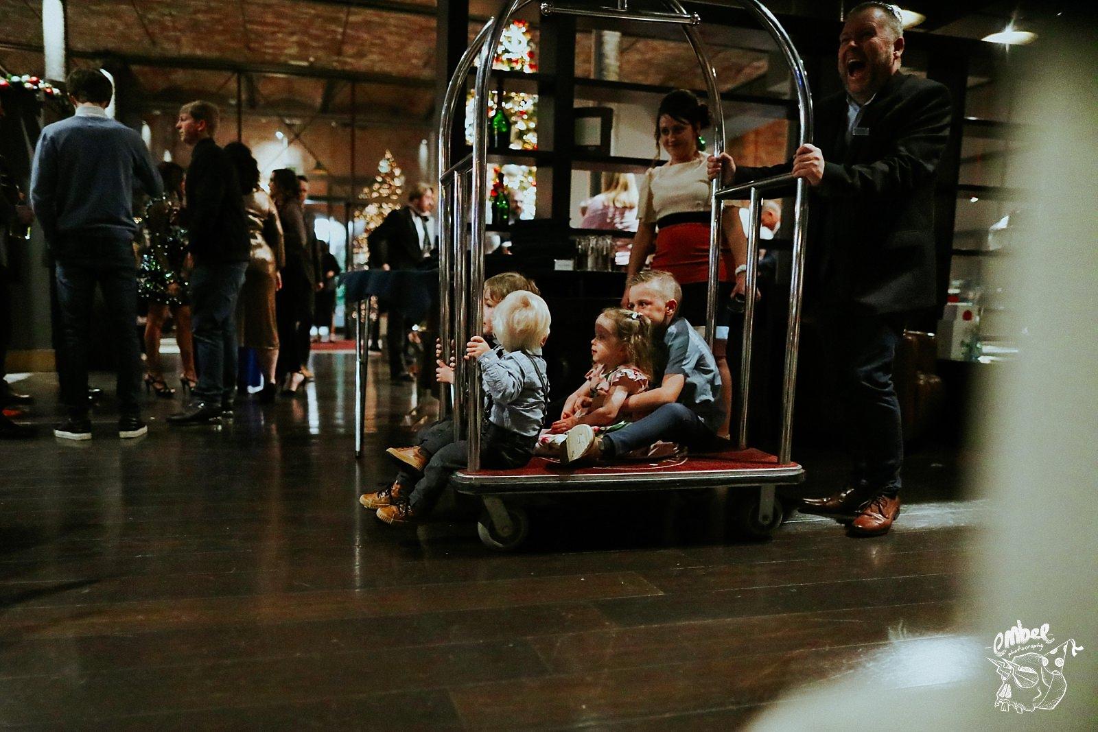 wedding kids on lobby trolly