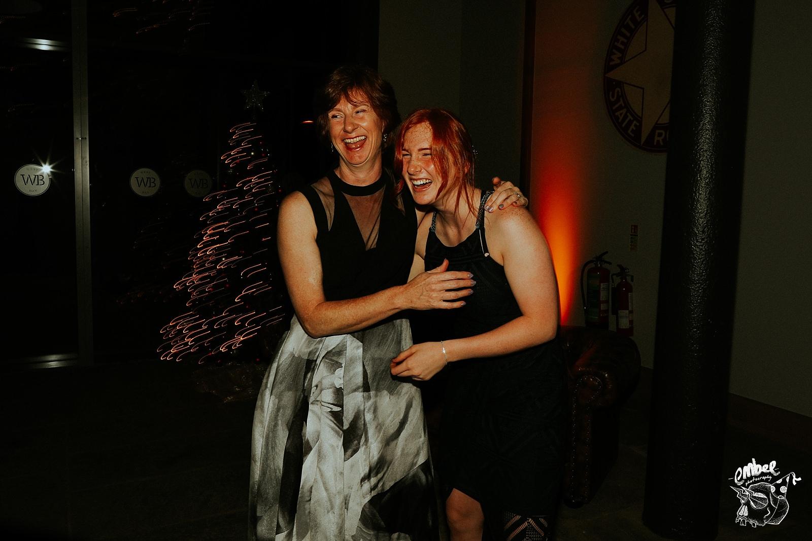 laughing mum and daughter at wedding