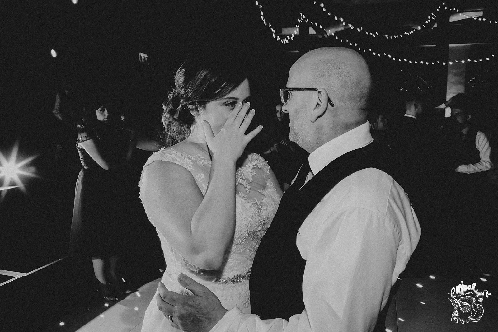 bride cries whilst dancing with dad