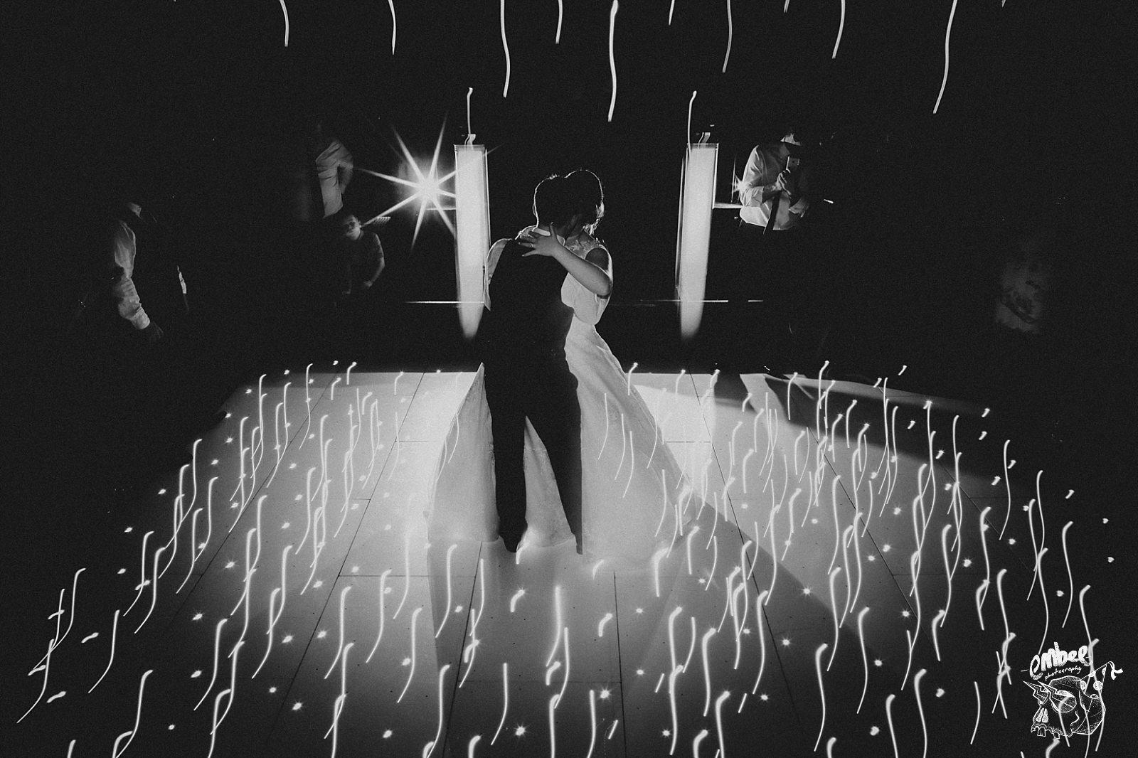 bride and groom first dance on sparkle dance floor