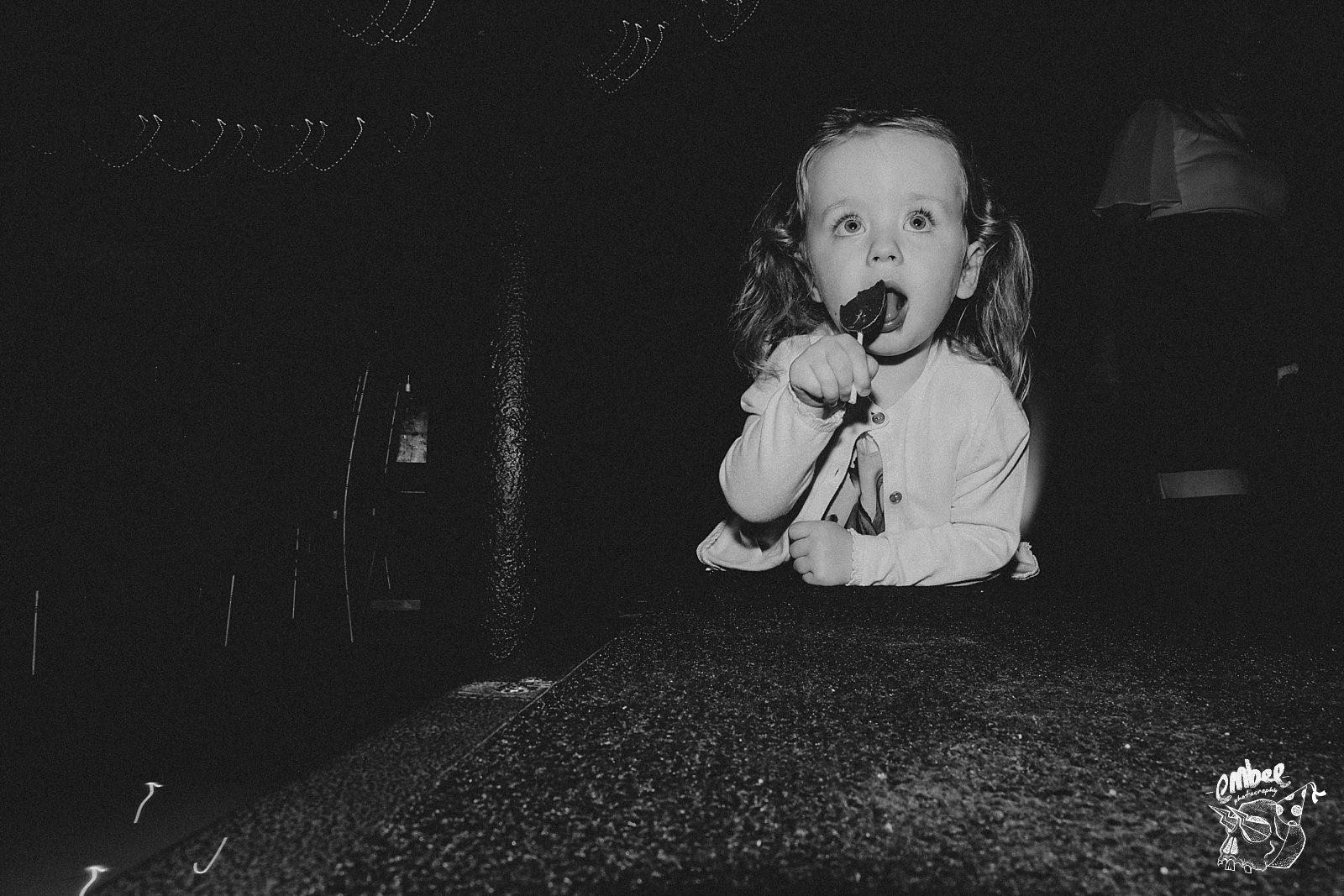 kid eating lollipop
