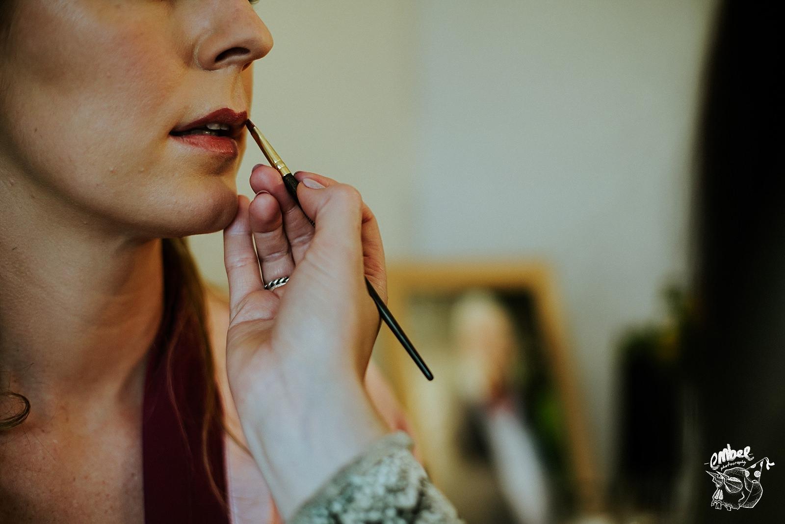 brides lipstick being put on