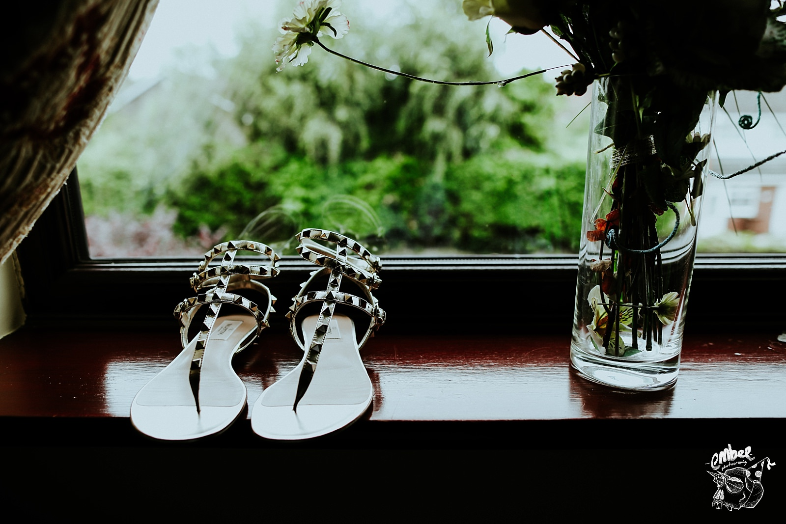 brides shoes on window ledge