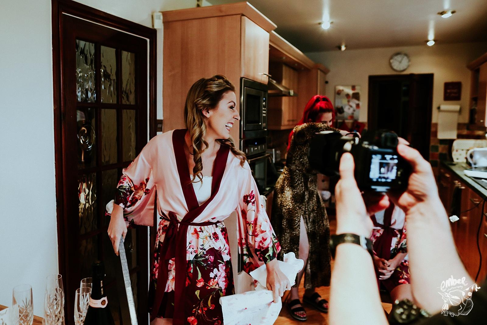 bride laughs at gift