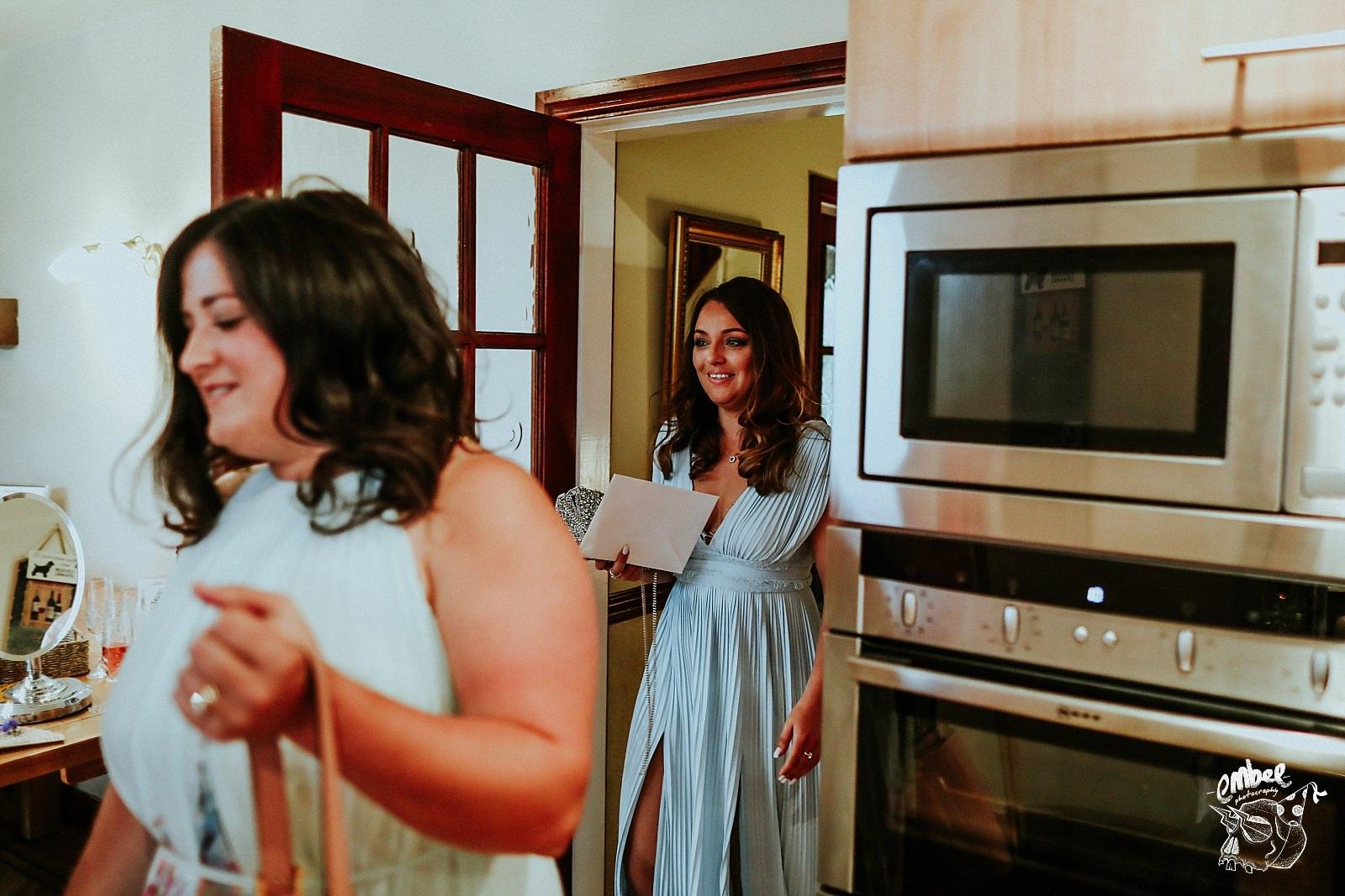 friends arrive at brides house