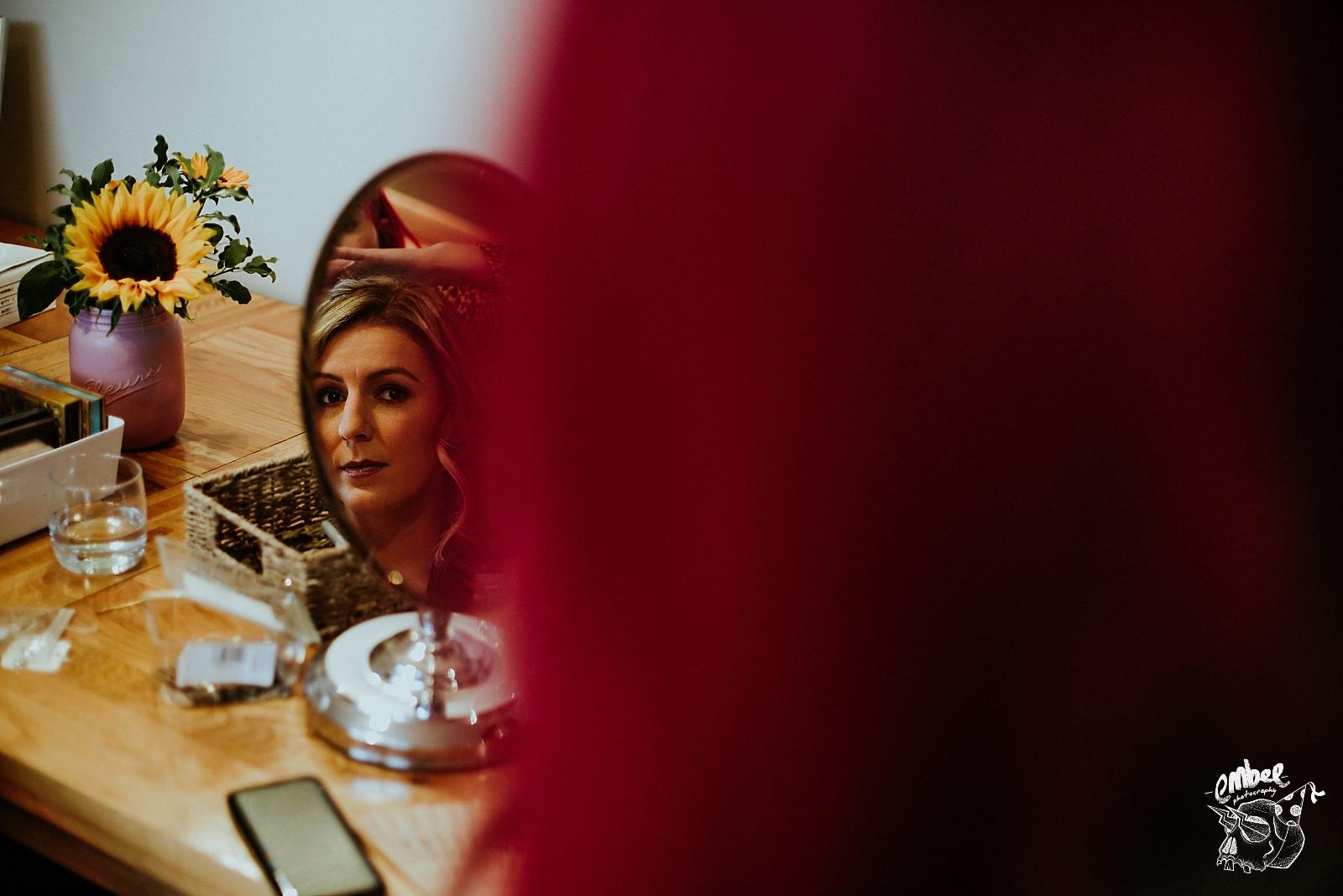 brides face in mirror