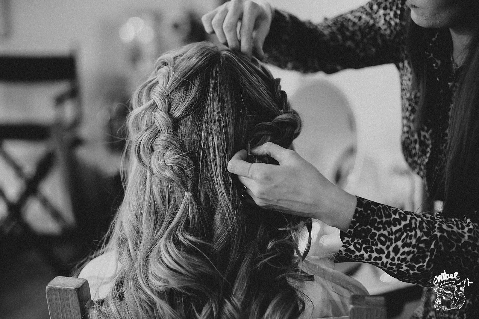 bride hair being done by hairdresser