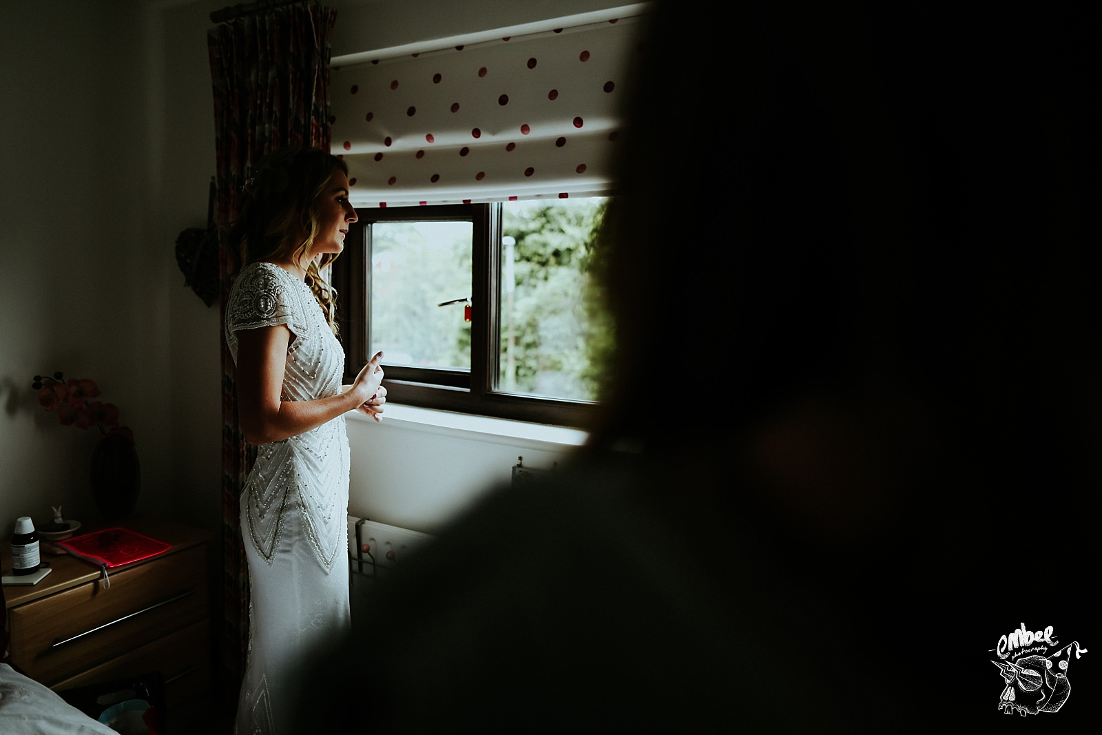 bride taking deep breath after putting dress on