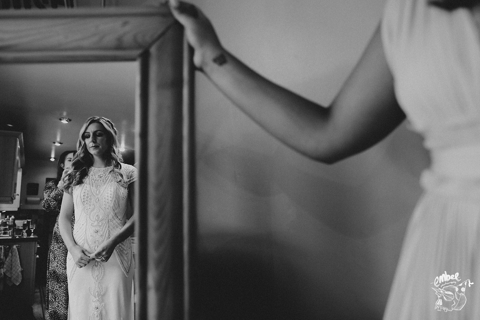 bride in mirror after putting on dress