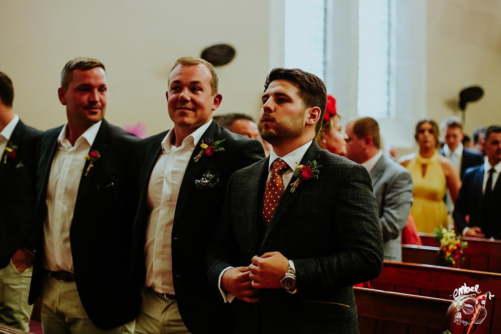nervous groom exhales