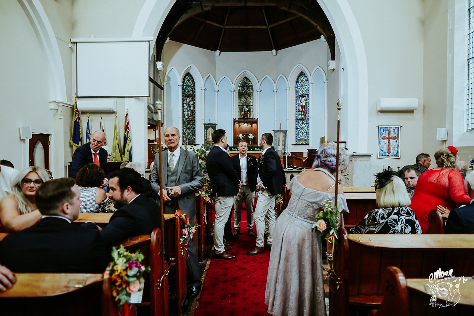 grooms and guest in church