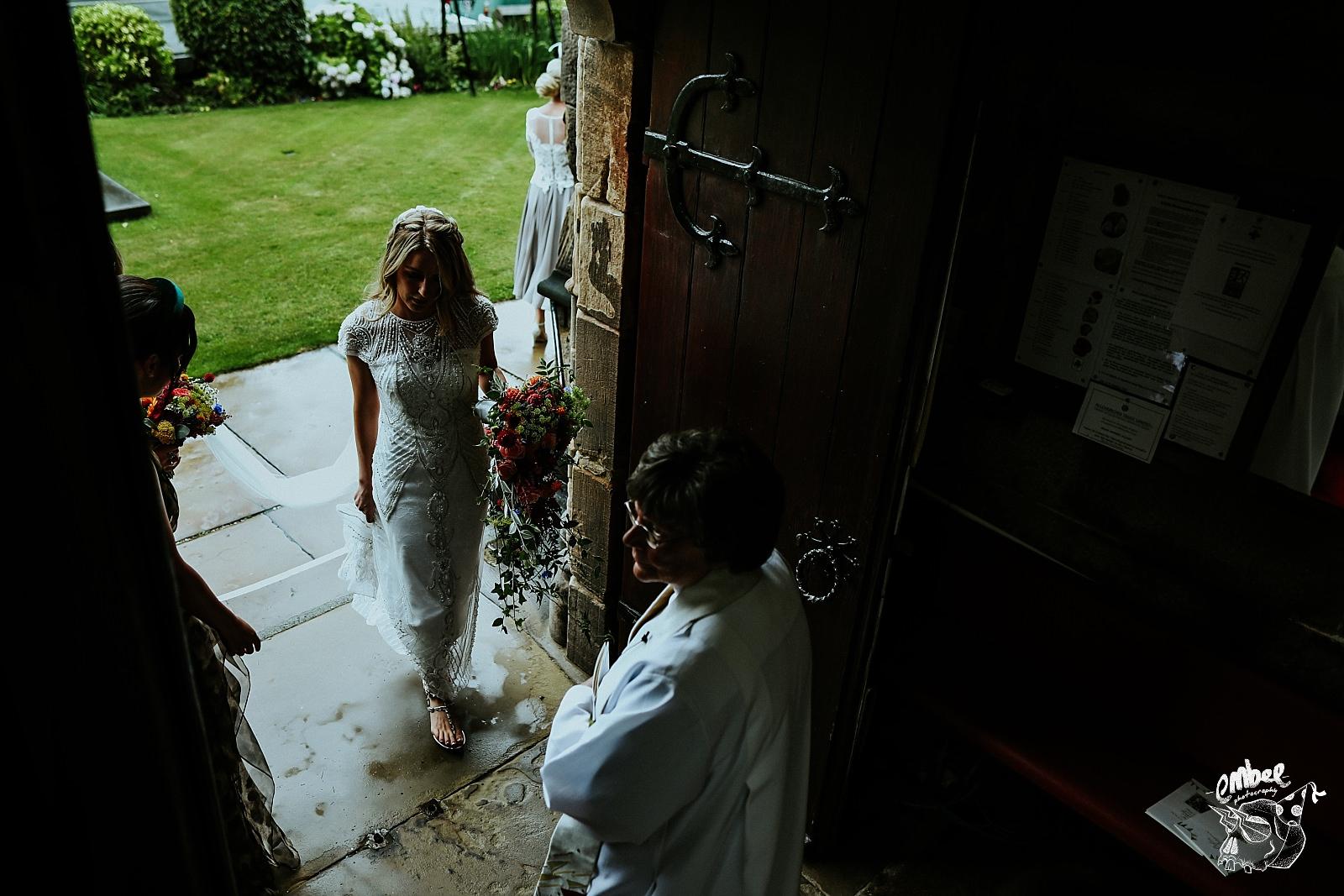 brides arrives in church