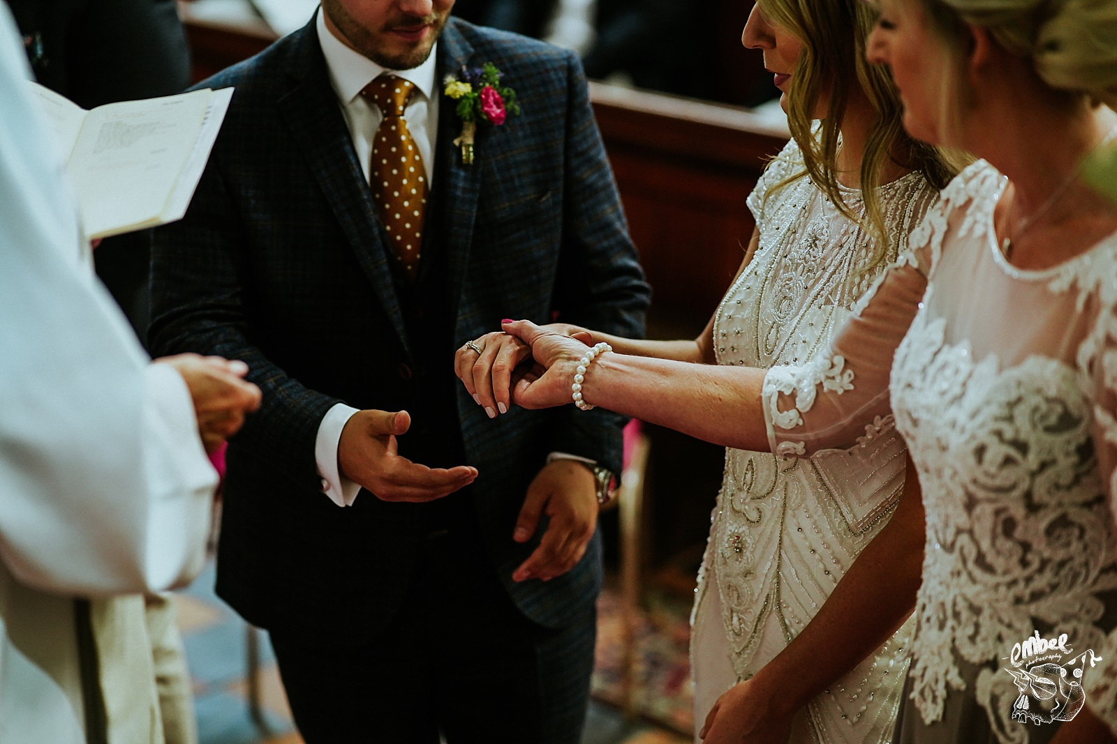 mum gives hand of the bride to groom