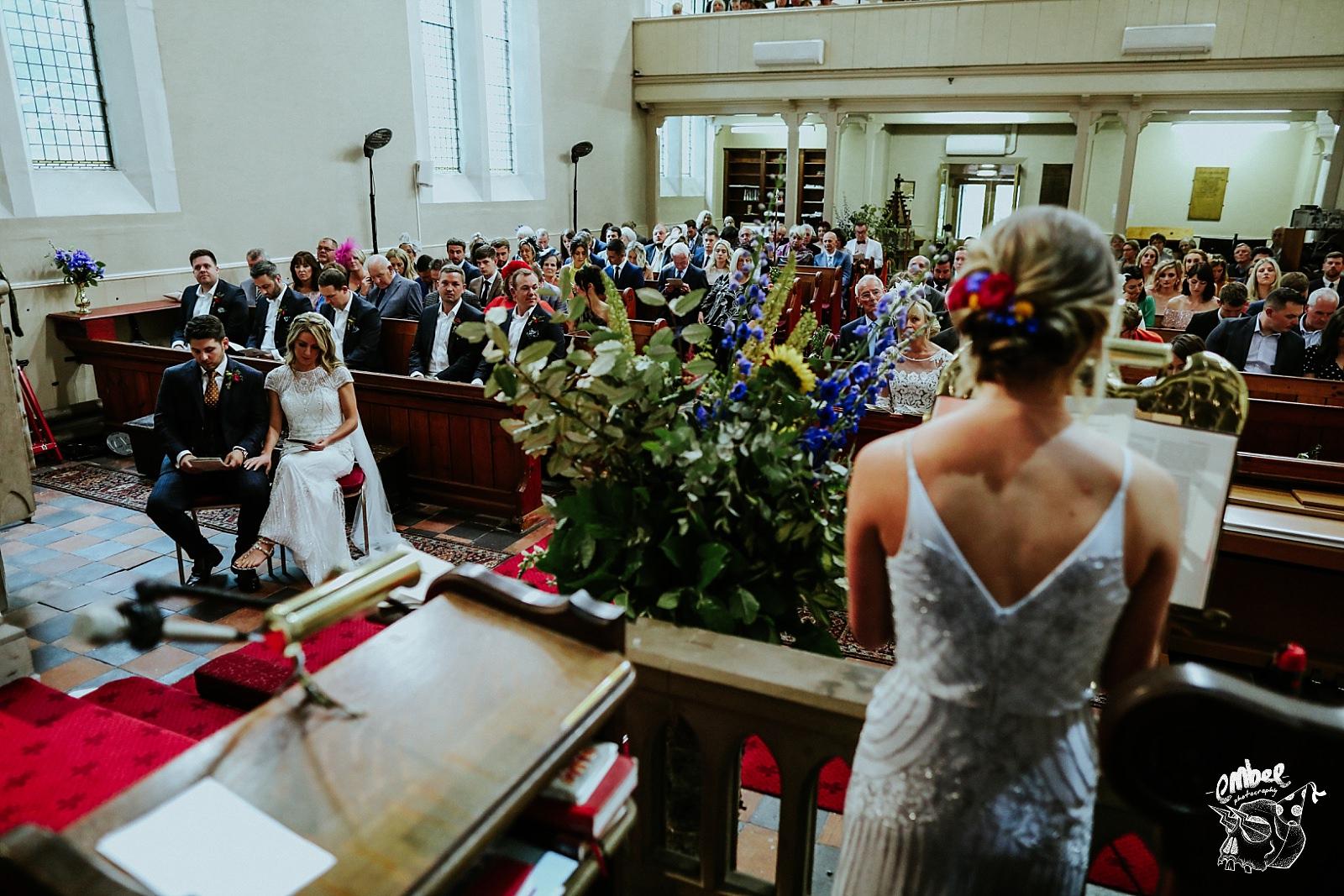 bridesmaids reading in church