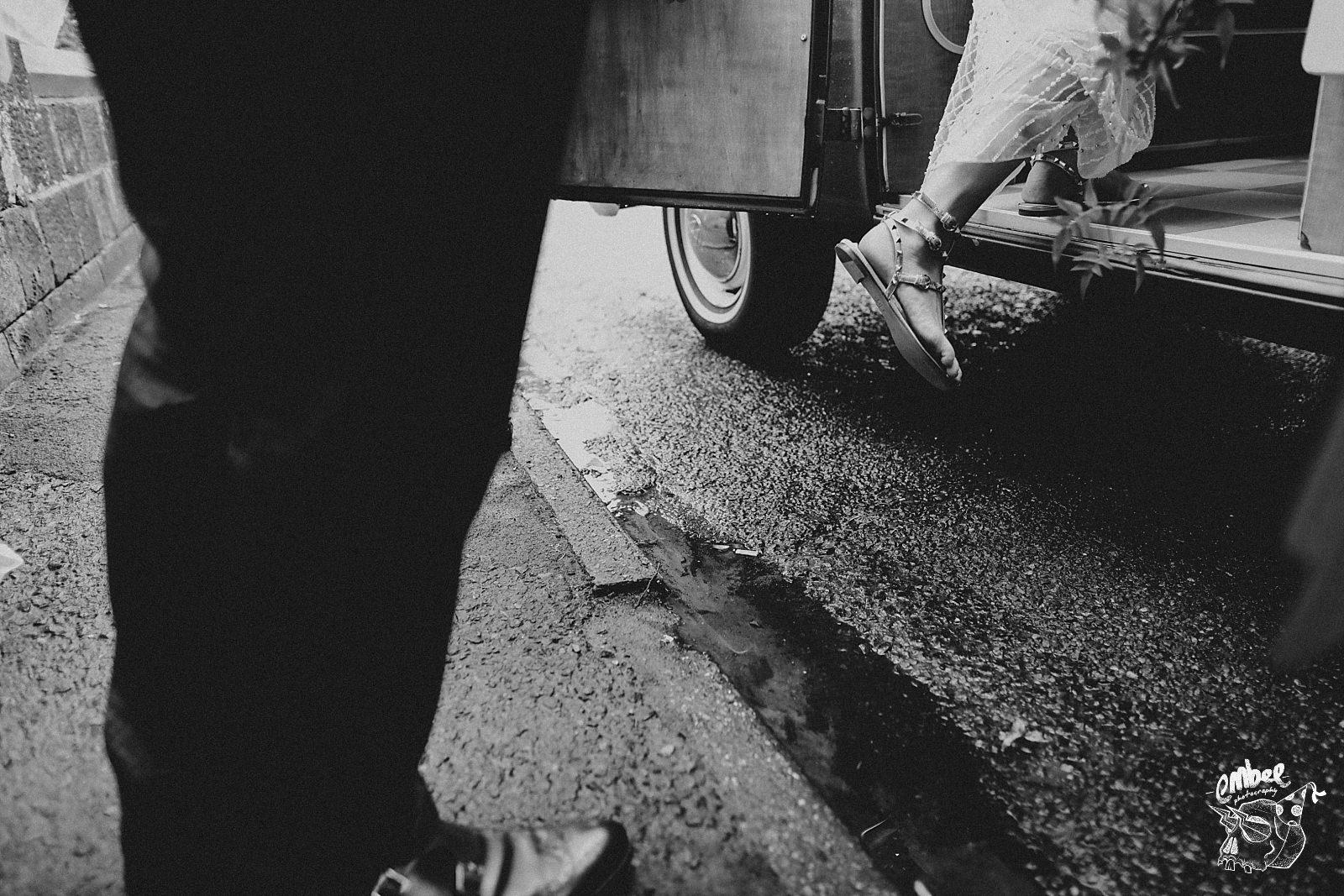 foot of the bride getting into camper van