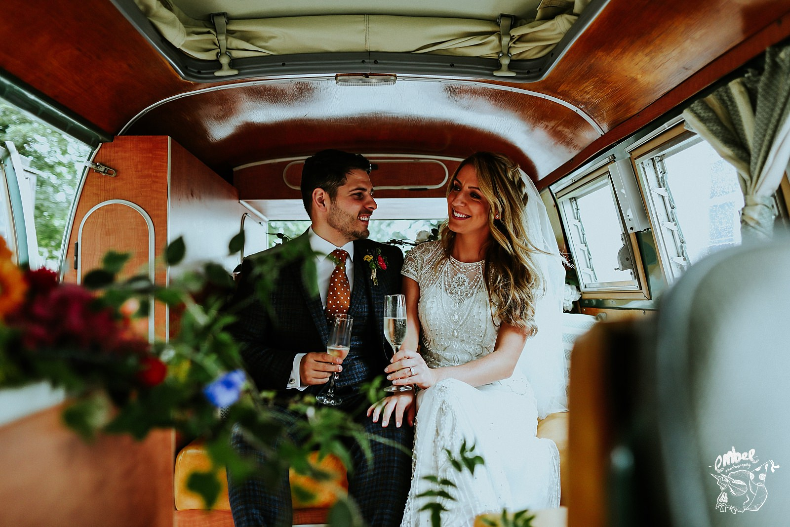 bride and groom in side camper van
