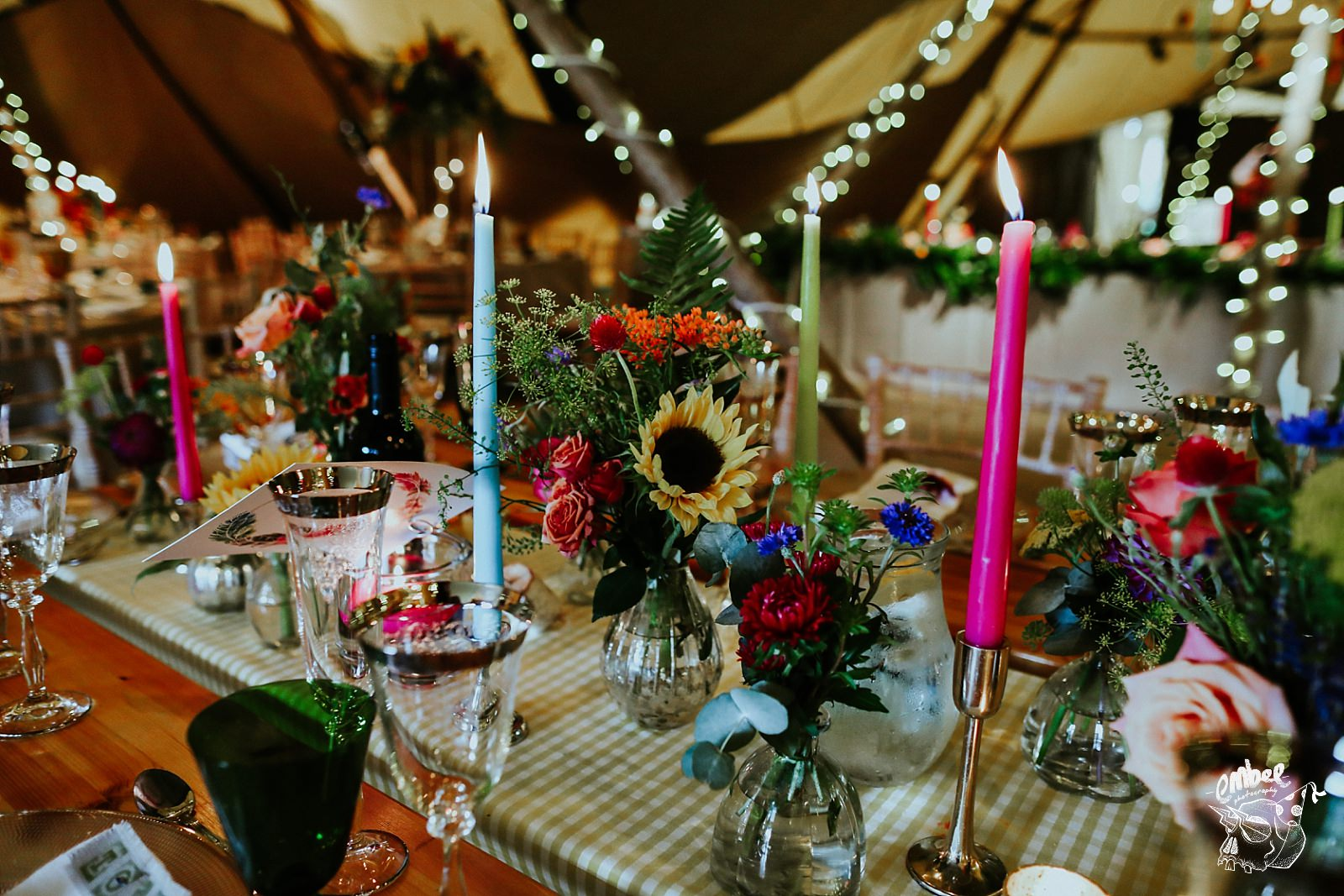 candles and flowers in tipi wedding