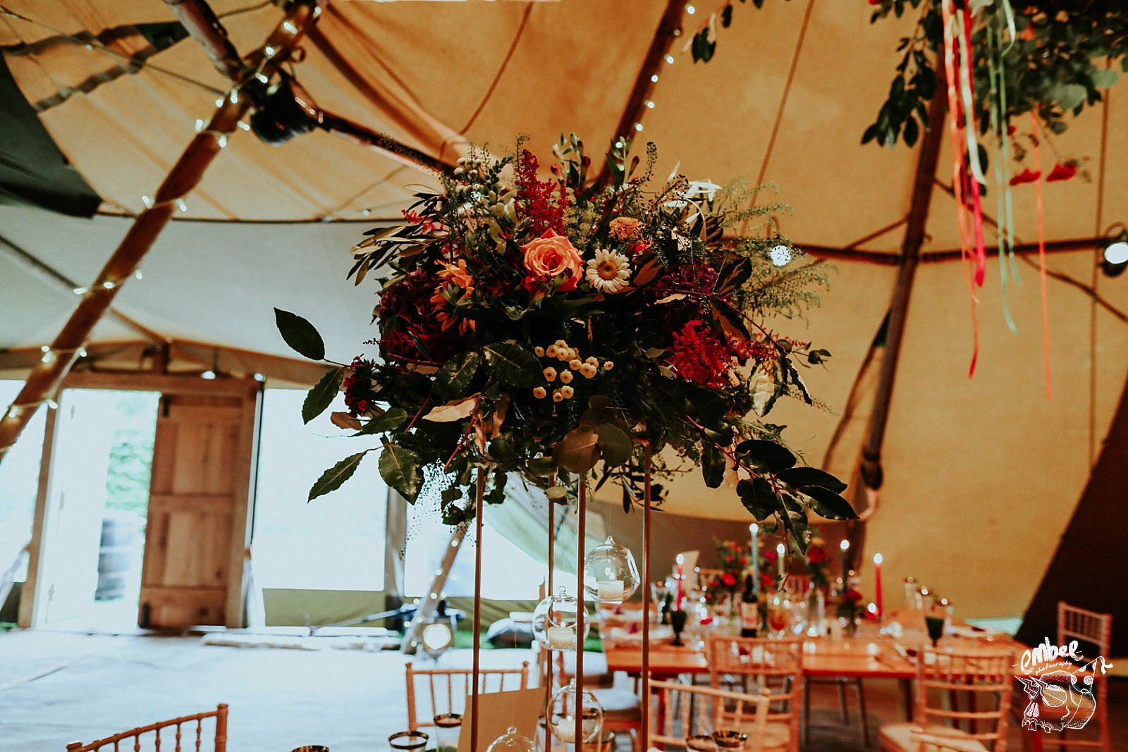 wedding flowers centre pieces in a tipi