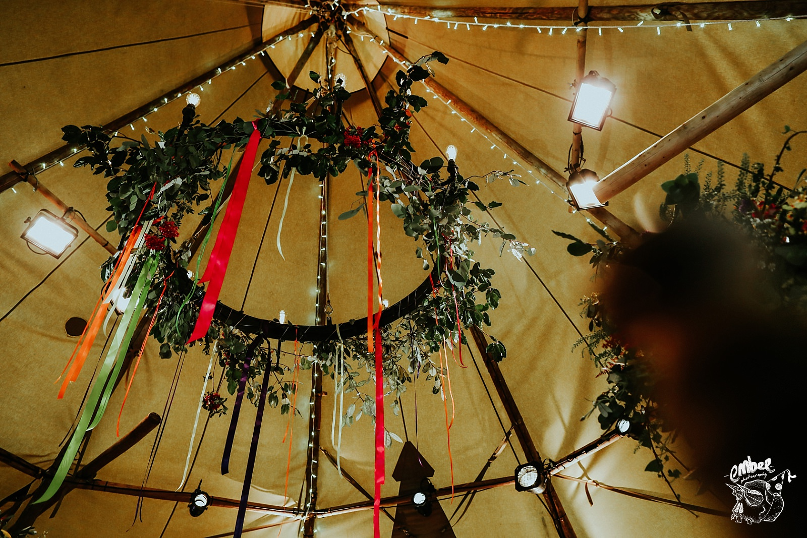 amazing chandelier at tipi wedding