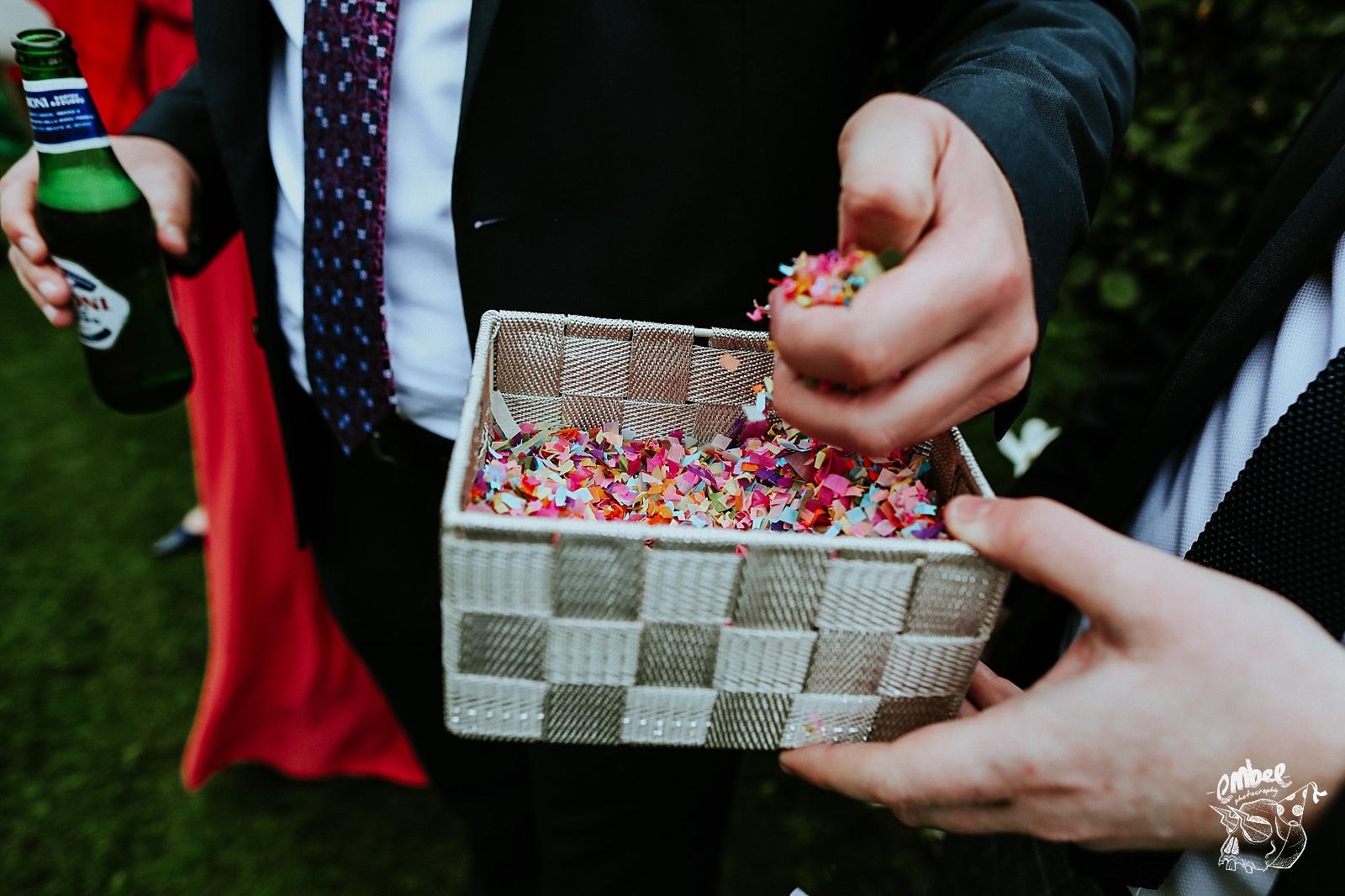 grabbing a handful of colourful confetti