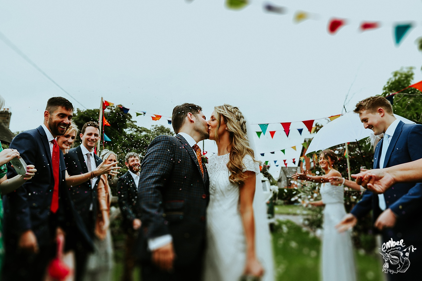 bride and groom kiss infront of wedding guests