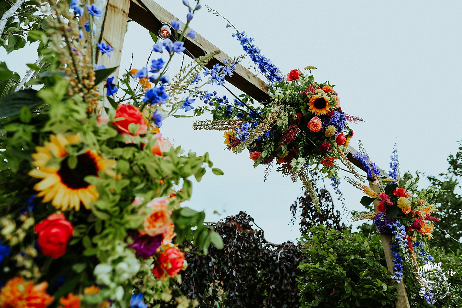 flower arrangements above grounds entrance