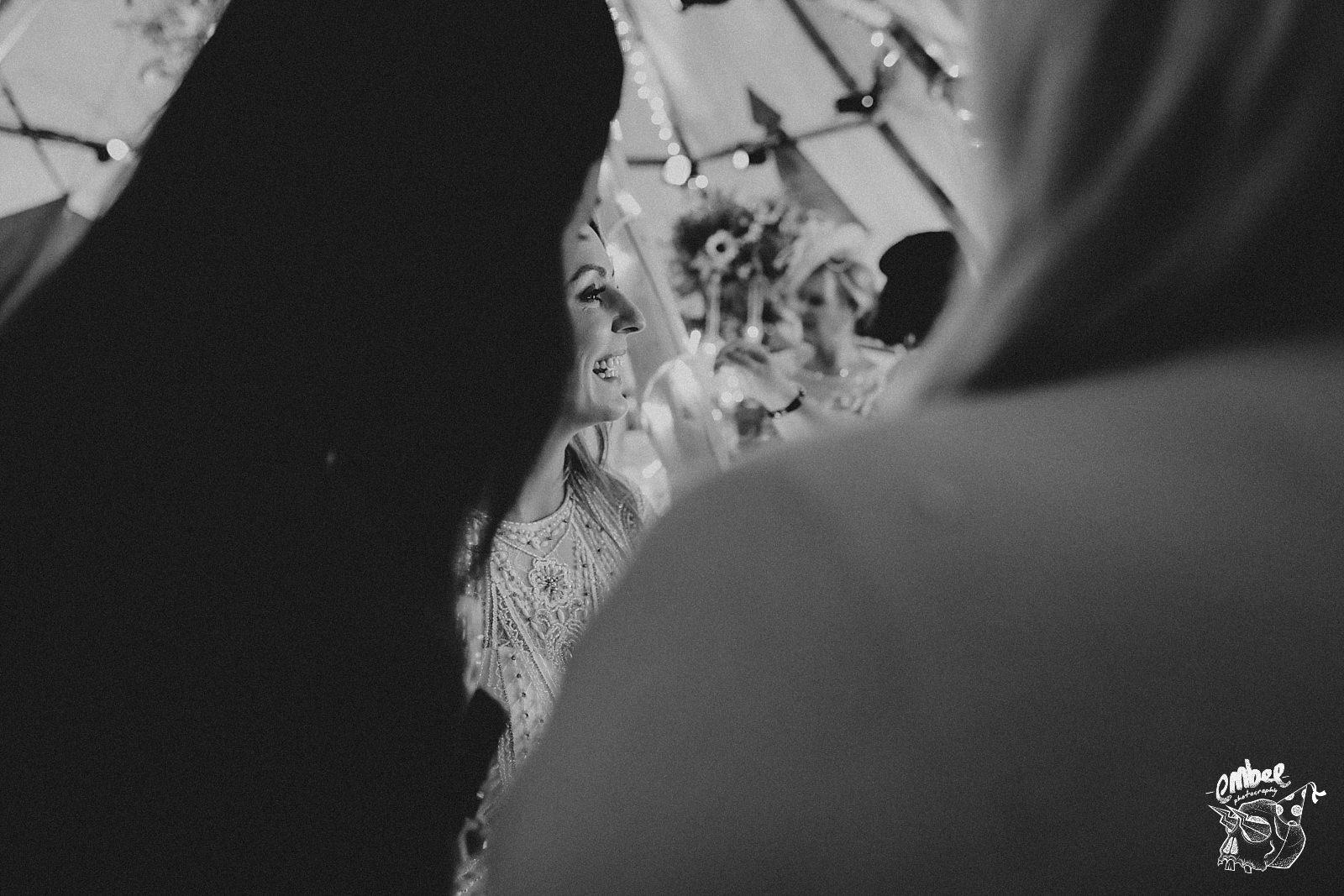 smiling bride at tipi wedding