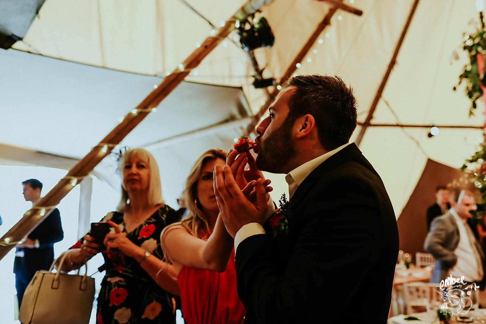 woman feeding man at wedding