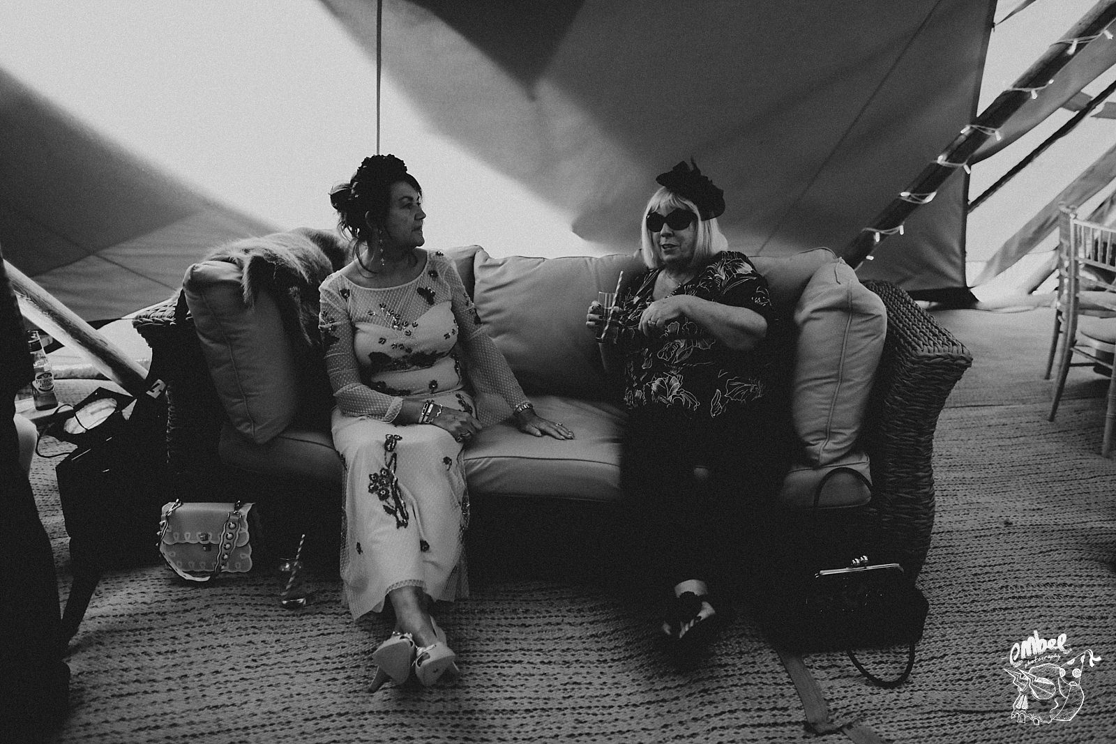 two woman on a couch