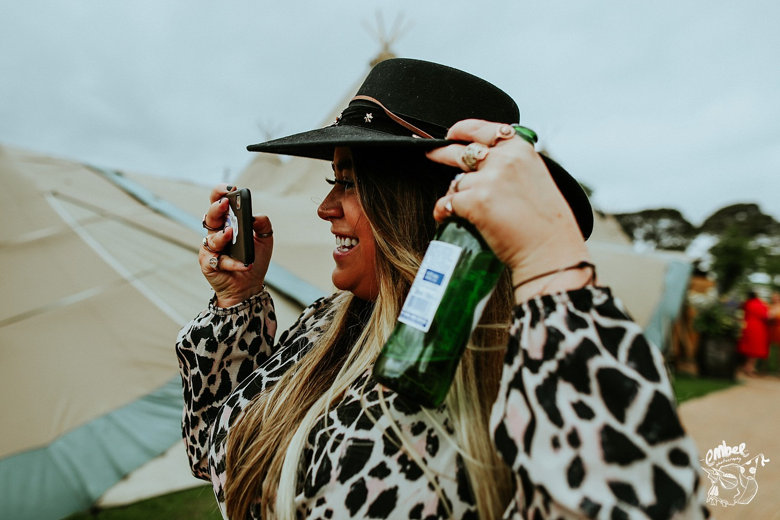 woman taking picture with beer in hand