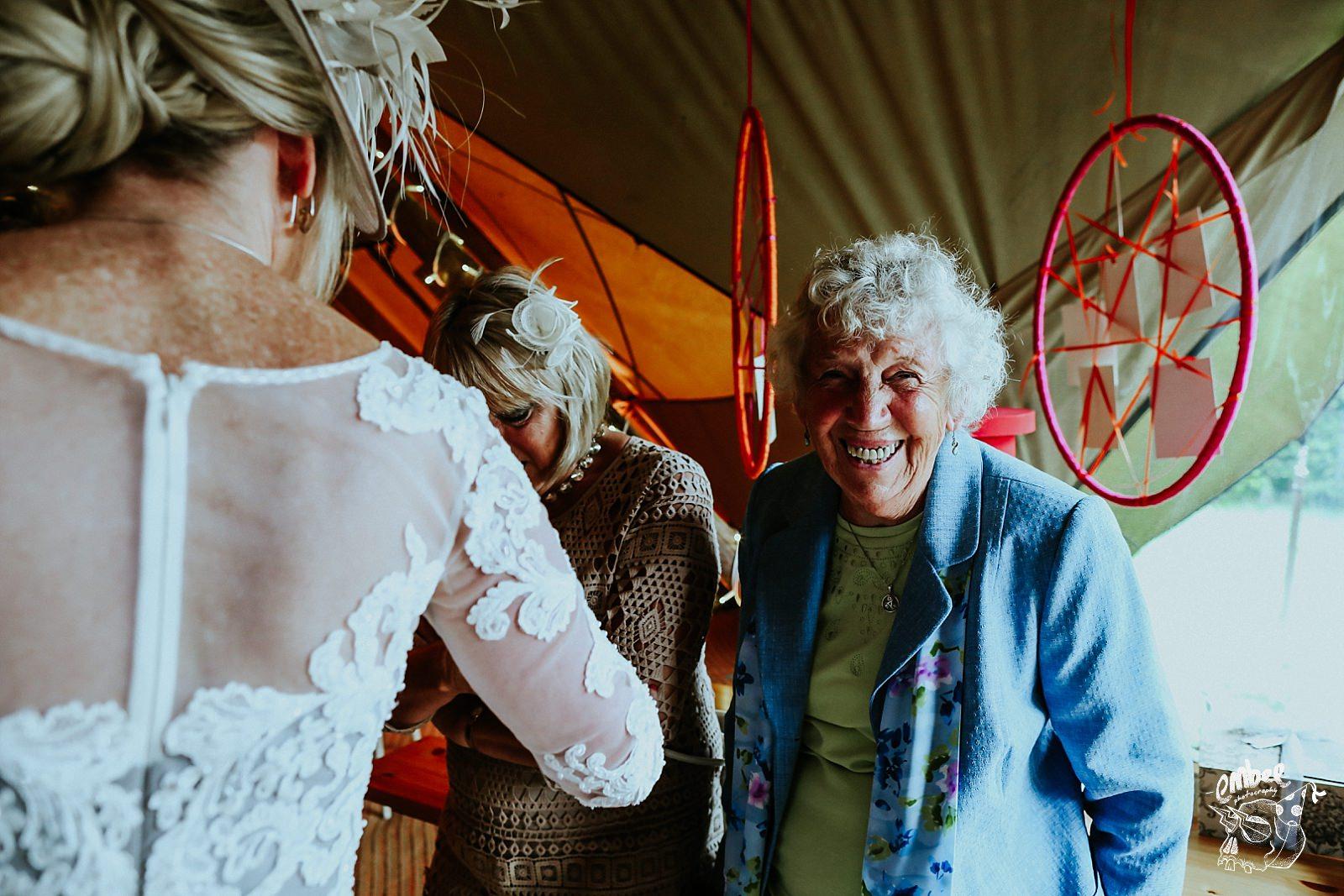 smiling granma at the camera