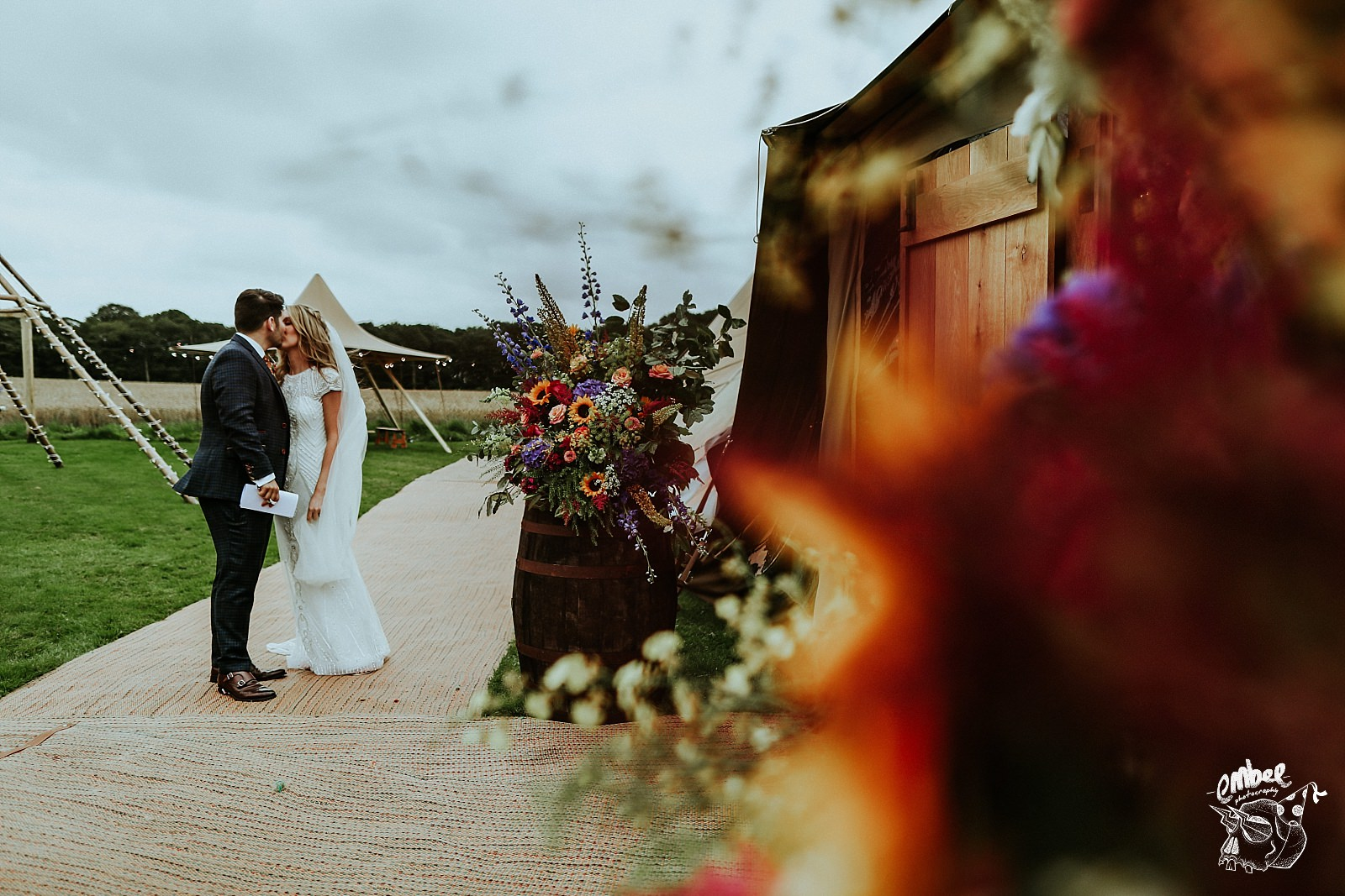 bride and groom kiss before going into wedding breakfast