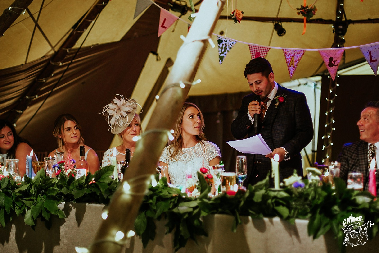 groom reading his speech