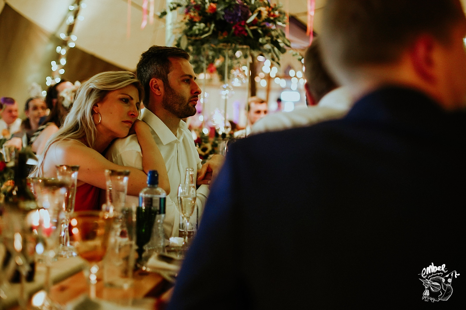 woman leans on man during the speeches to comfort him