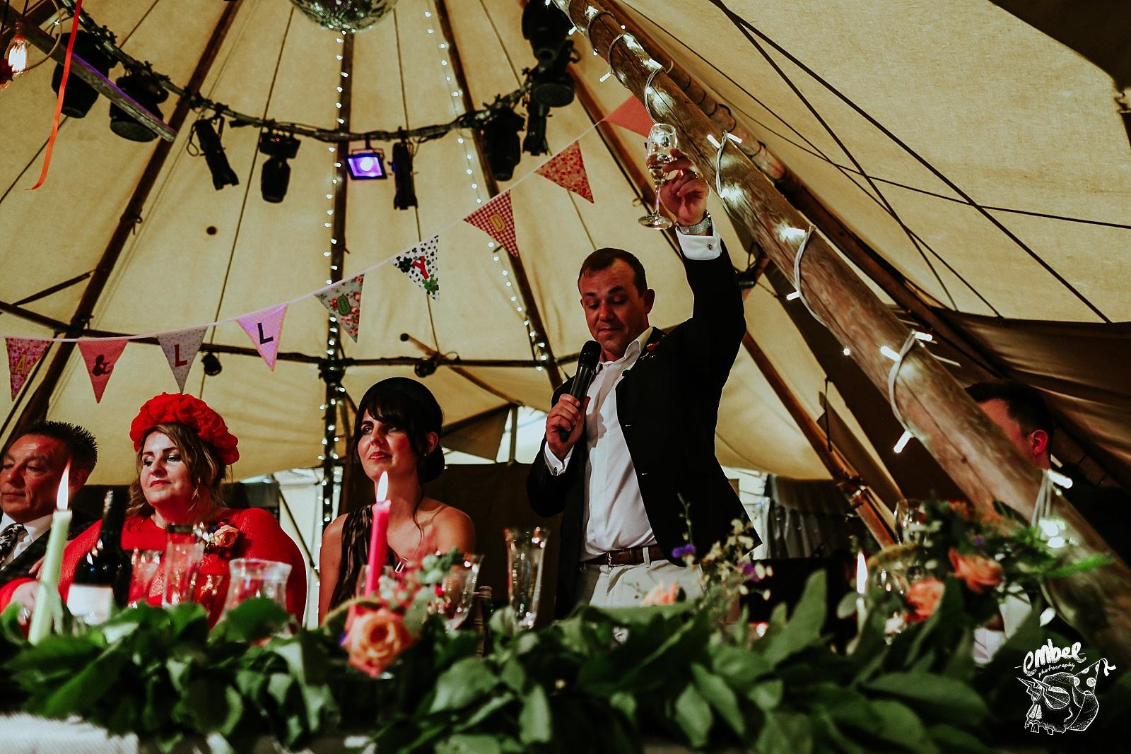 grooms friend being master of ceremonies