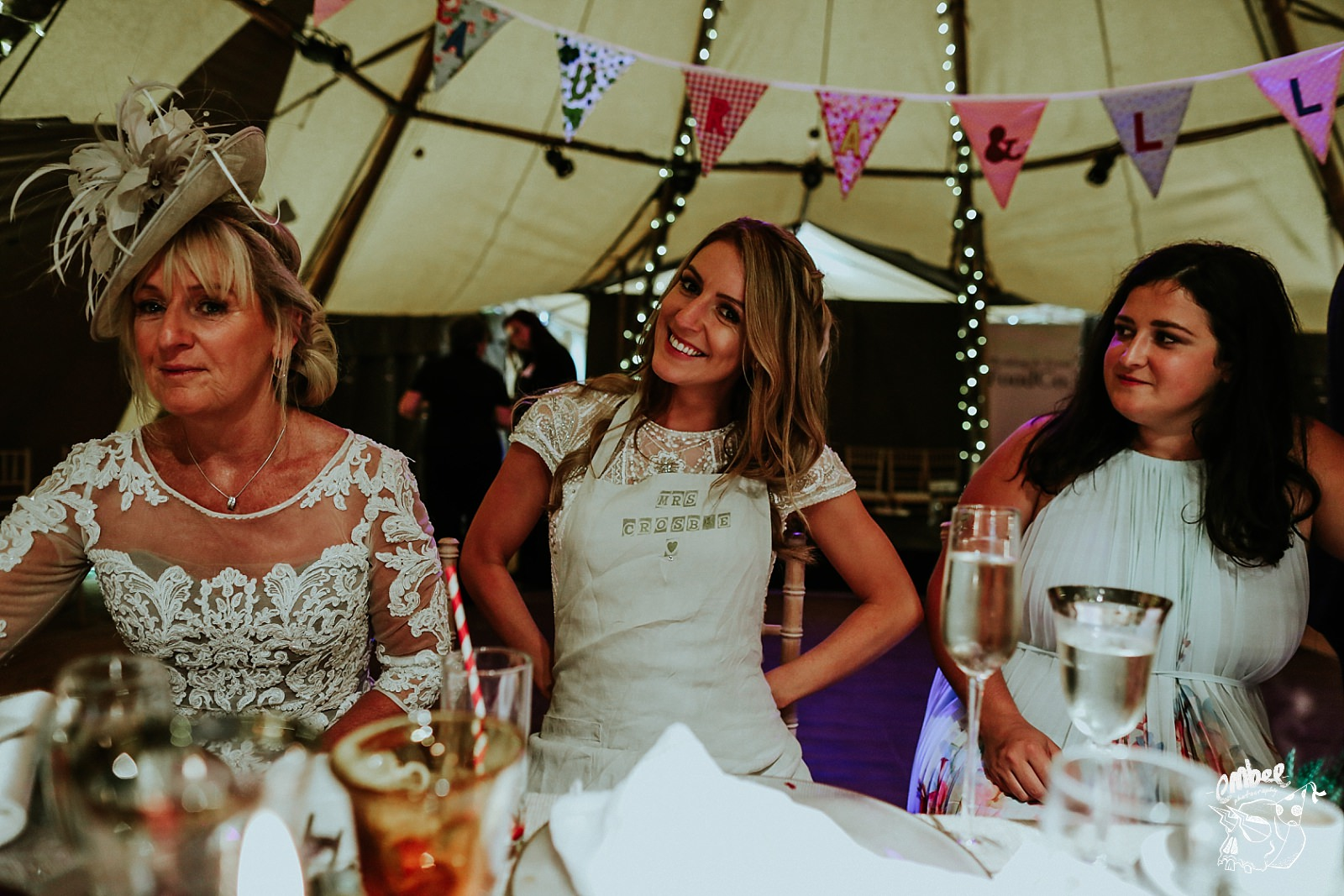 bride with dining apron with her name on it
