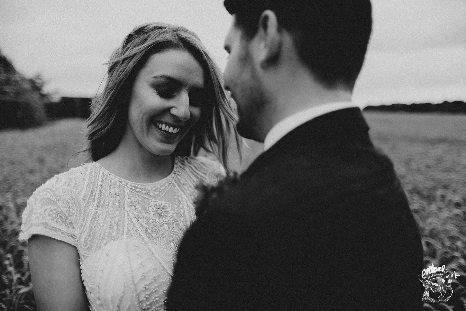 black and white photo of bride blushing