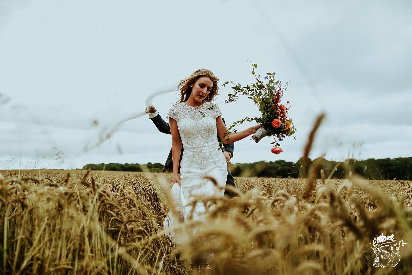 bride walking through a cornfield