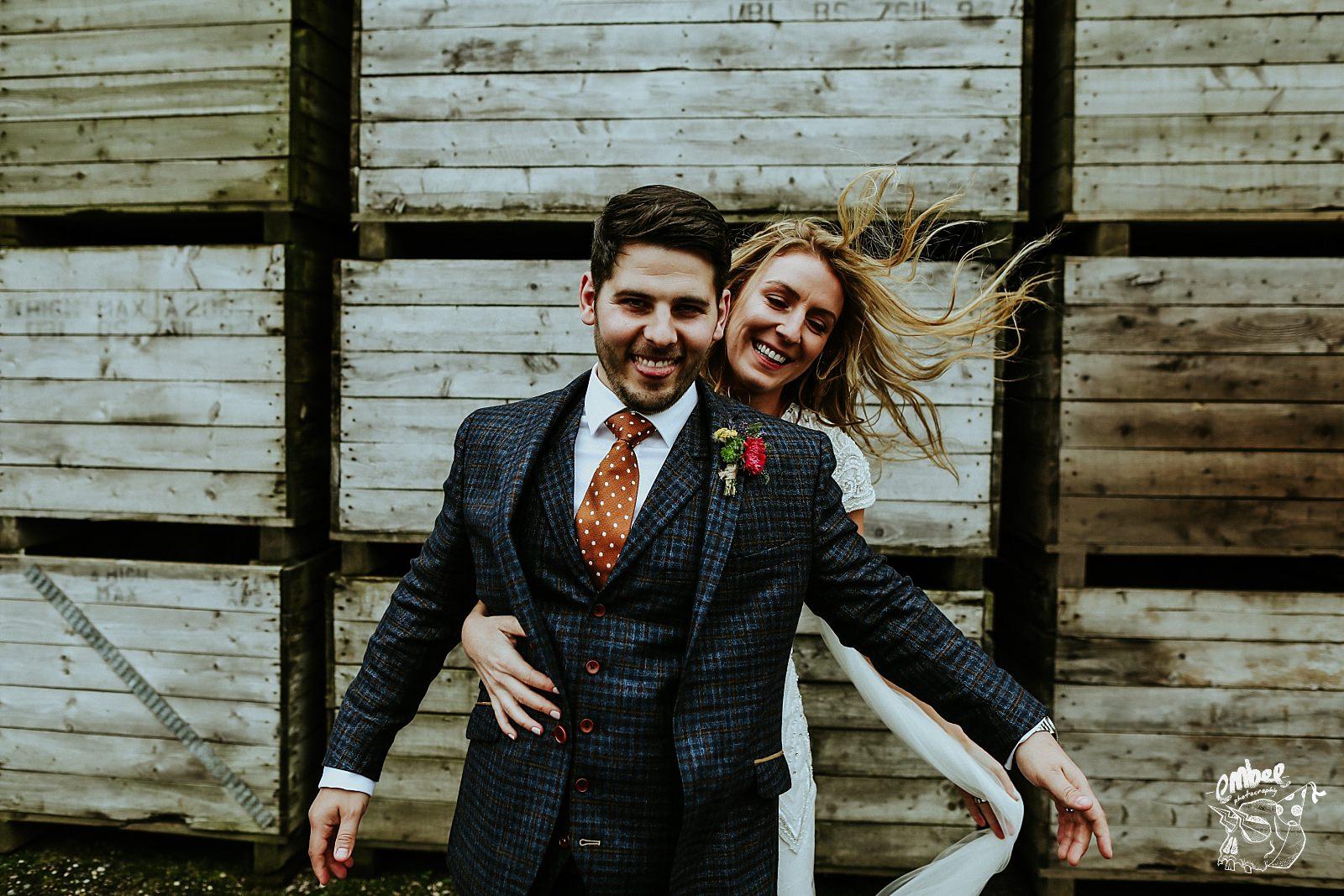 bride grabs groom around the waist