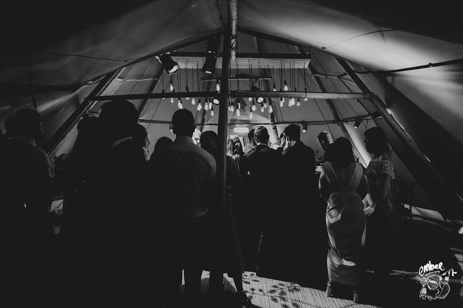 silhouette of people inside teepee