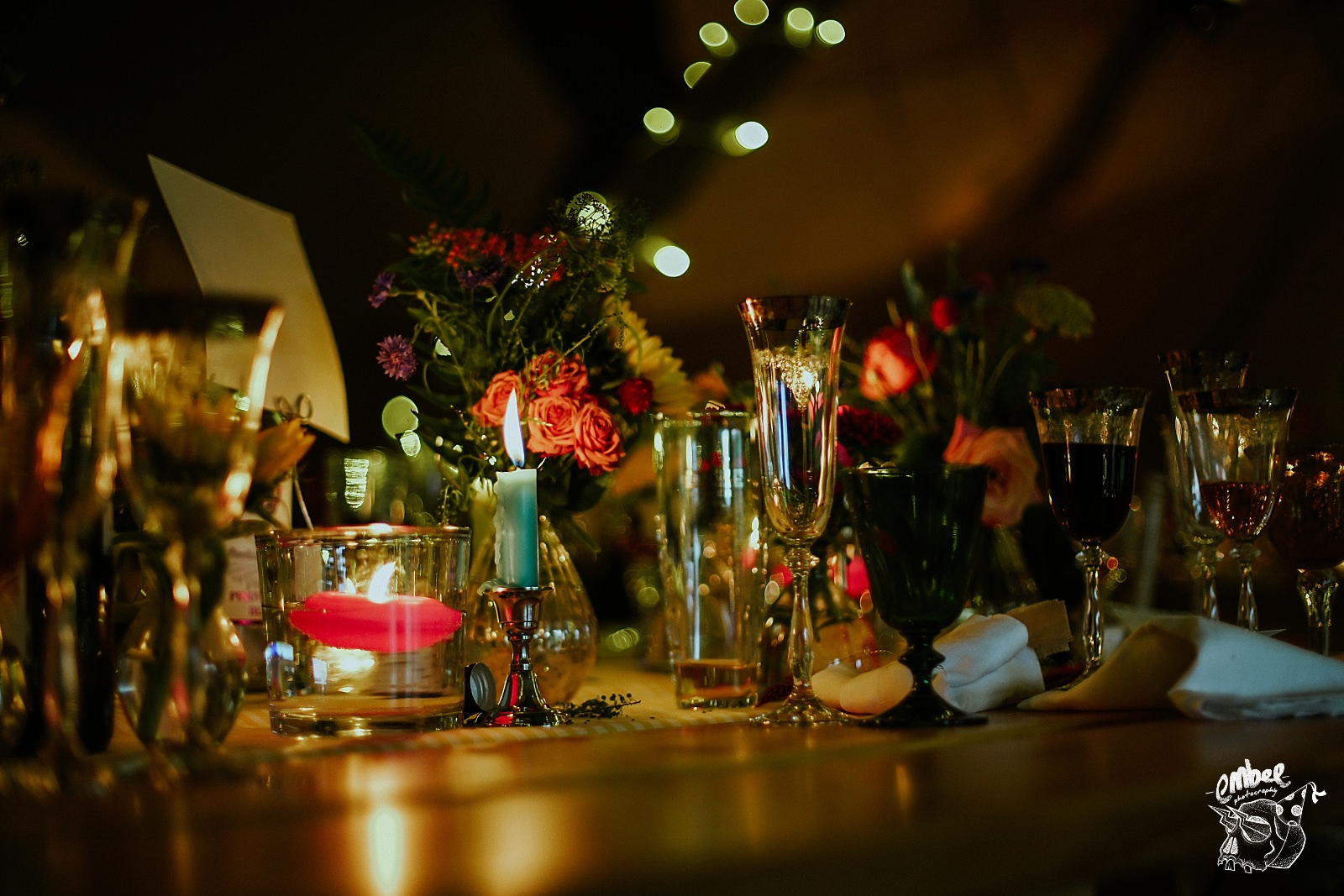flowers and candles on table