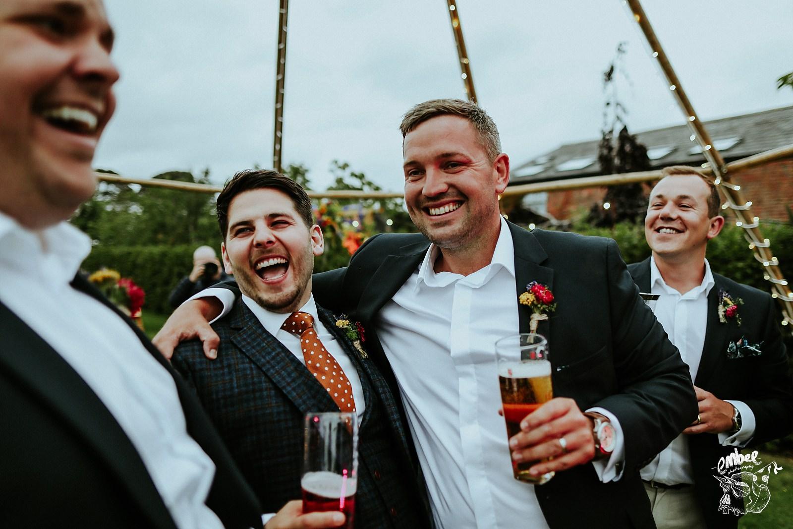 grooms joking around with groomsmen