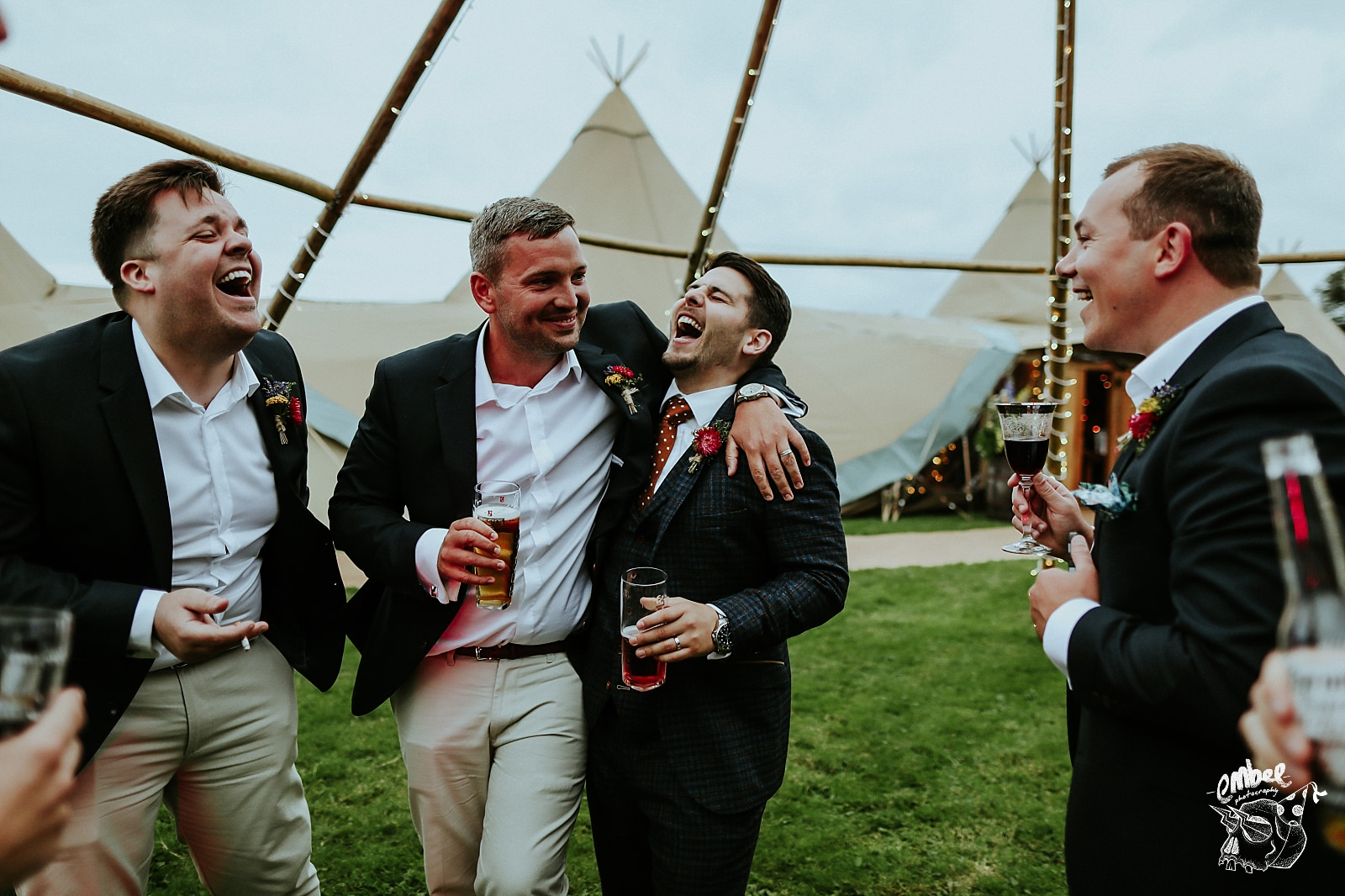 groom and best mate laugh