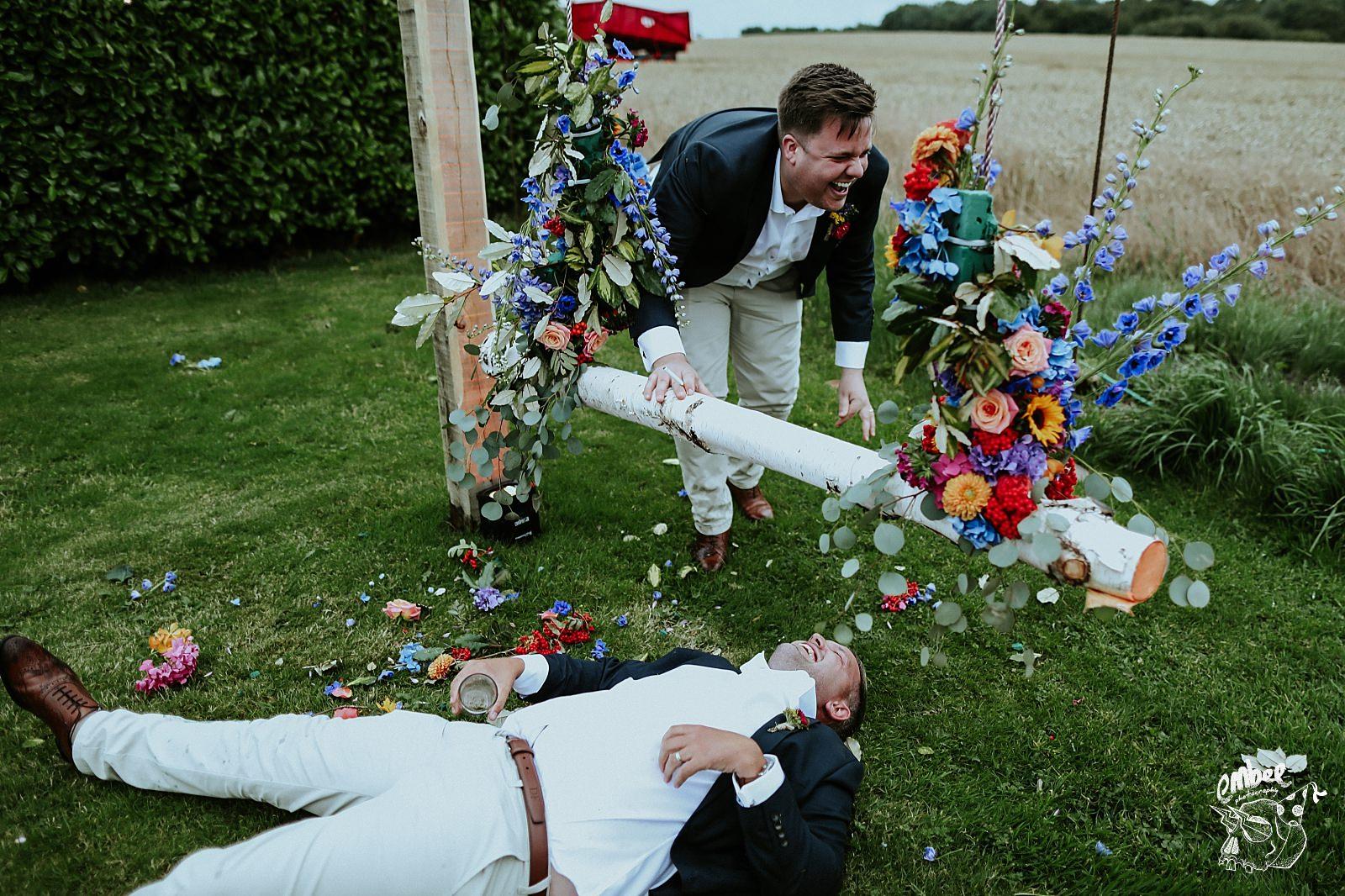 groomsman falls off swing