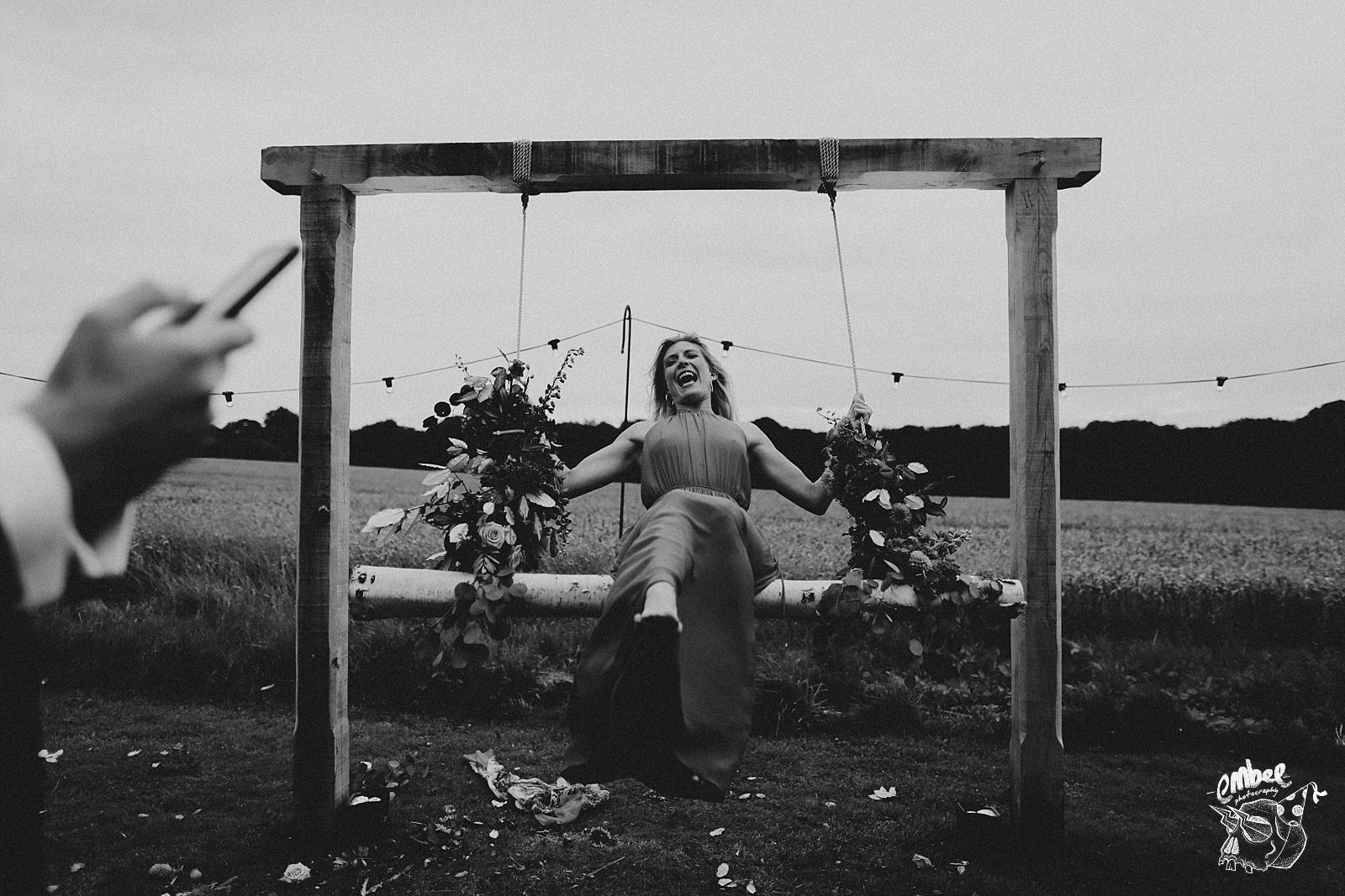 woman on giant wedding swing