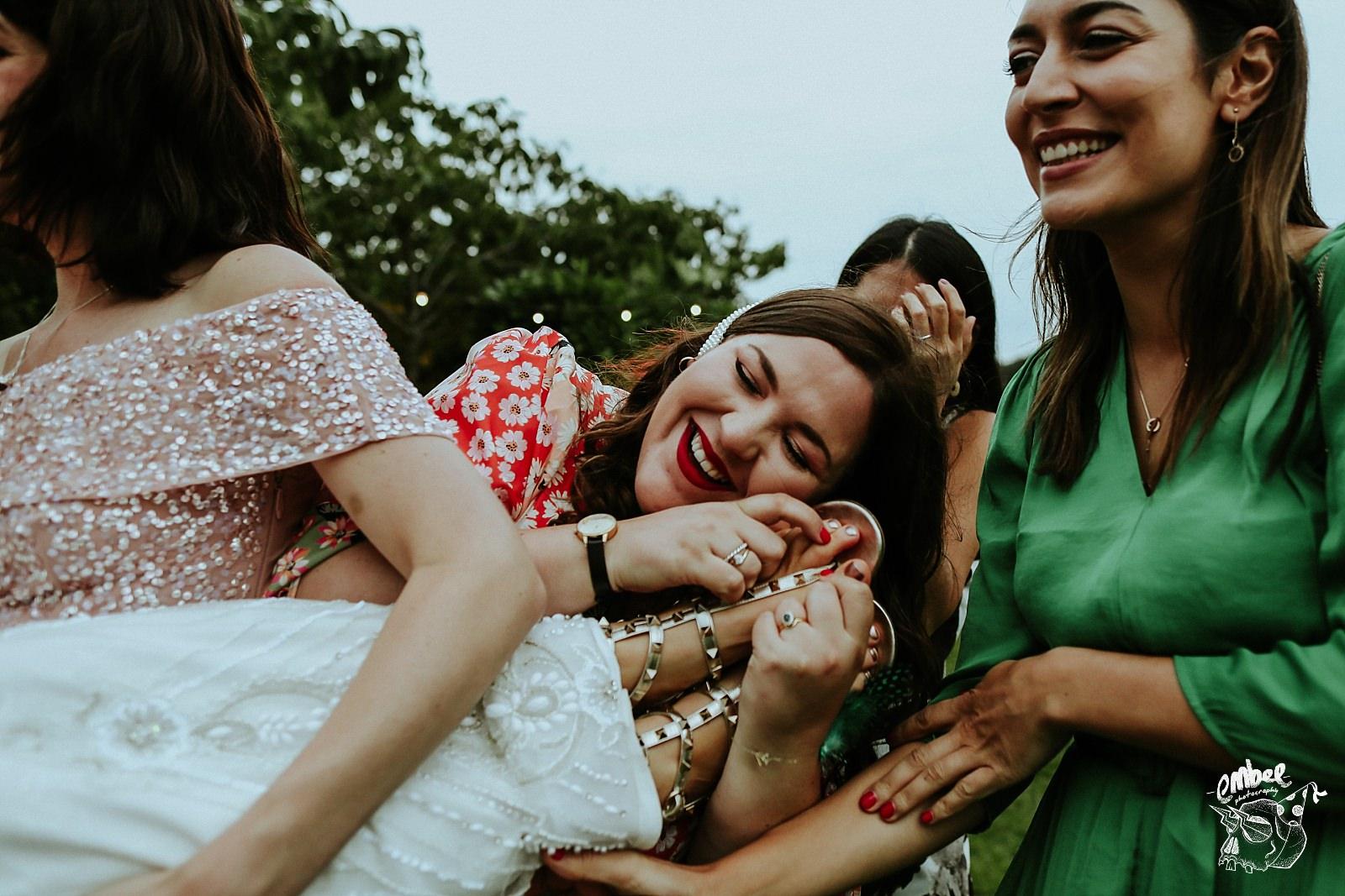 friend hugs bride feet