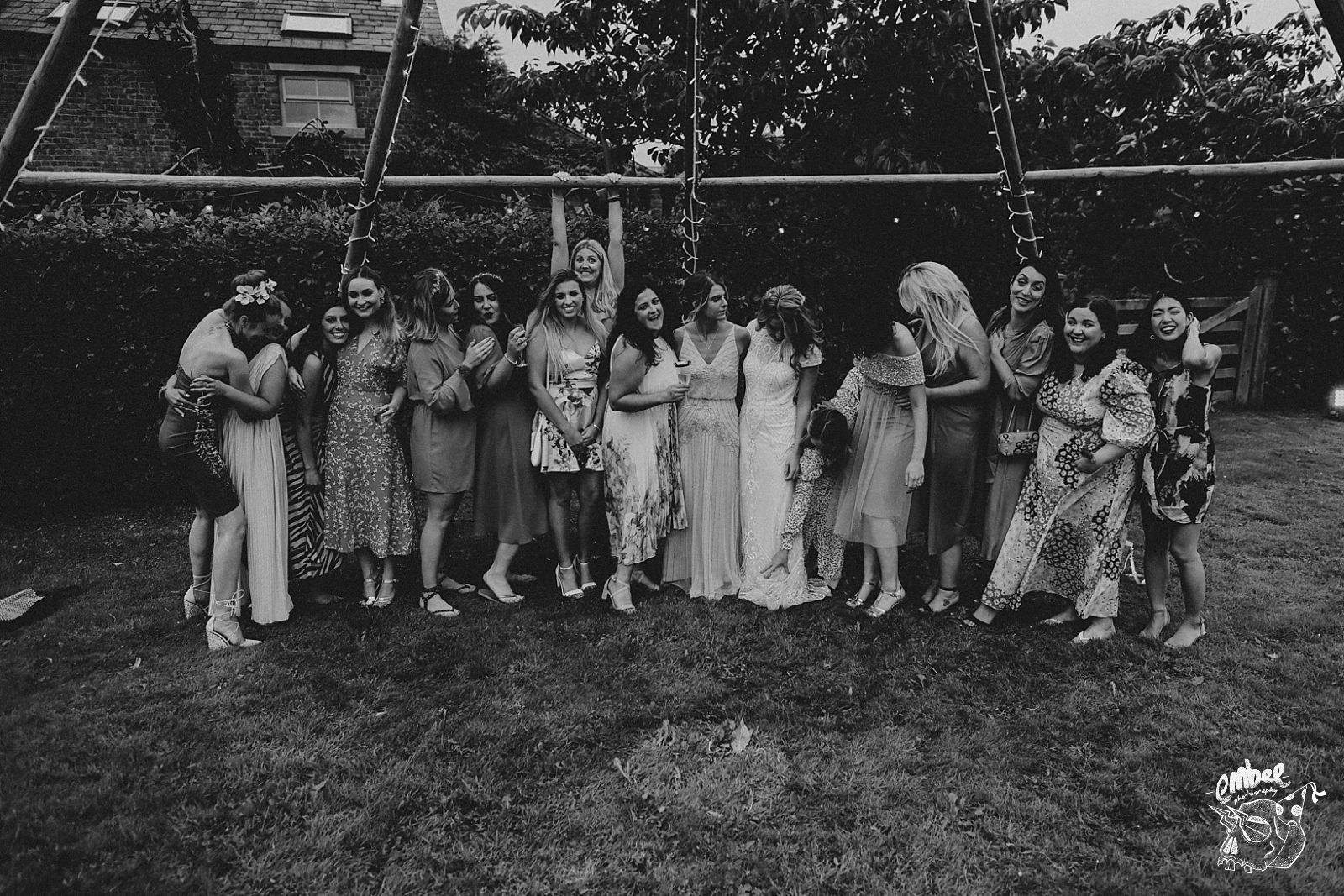 bride with a bunch of friends at her wedding