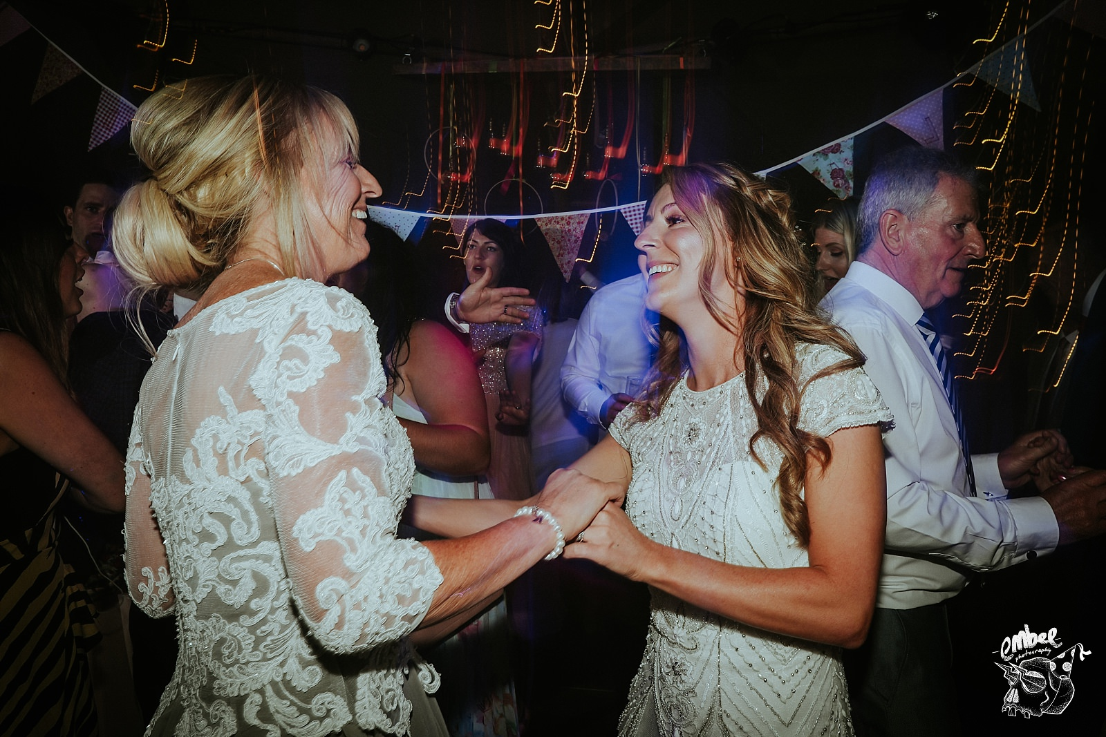 bride dances with mum at wedding
