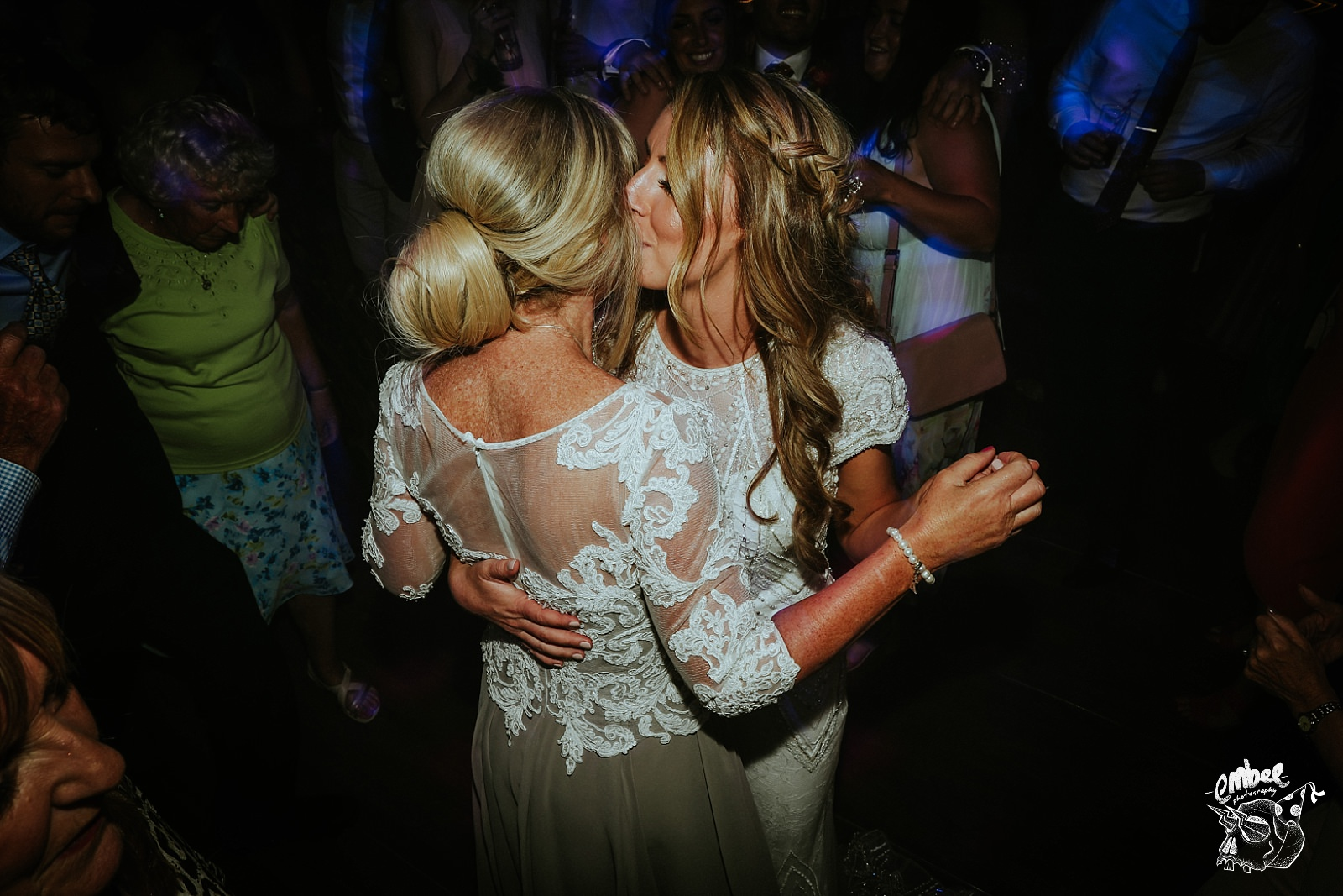 bride kisses mum on cheek
